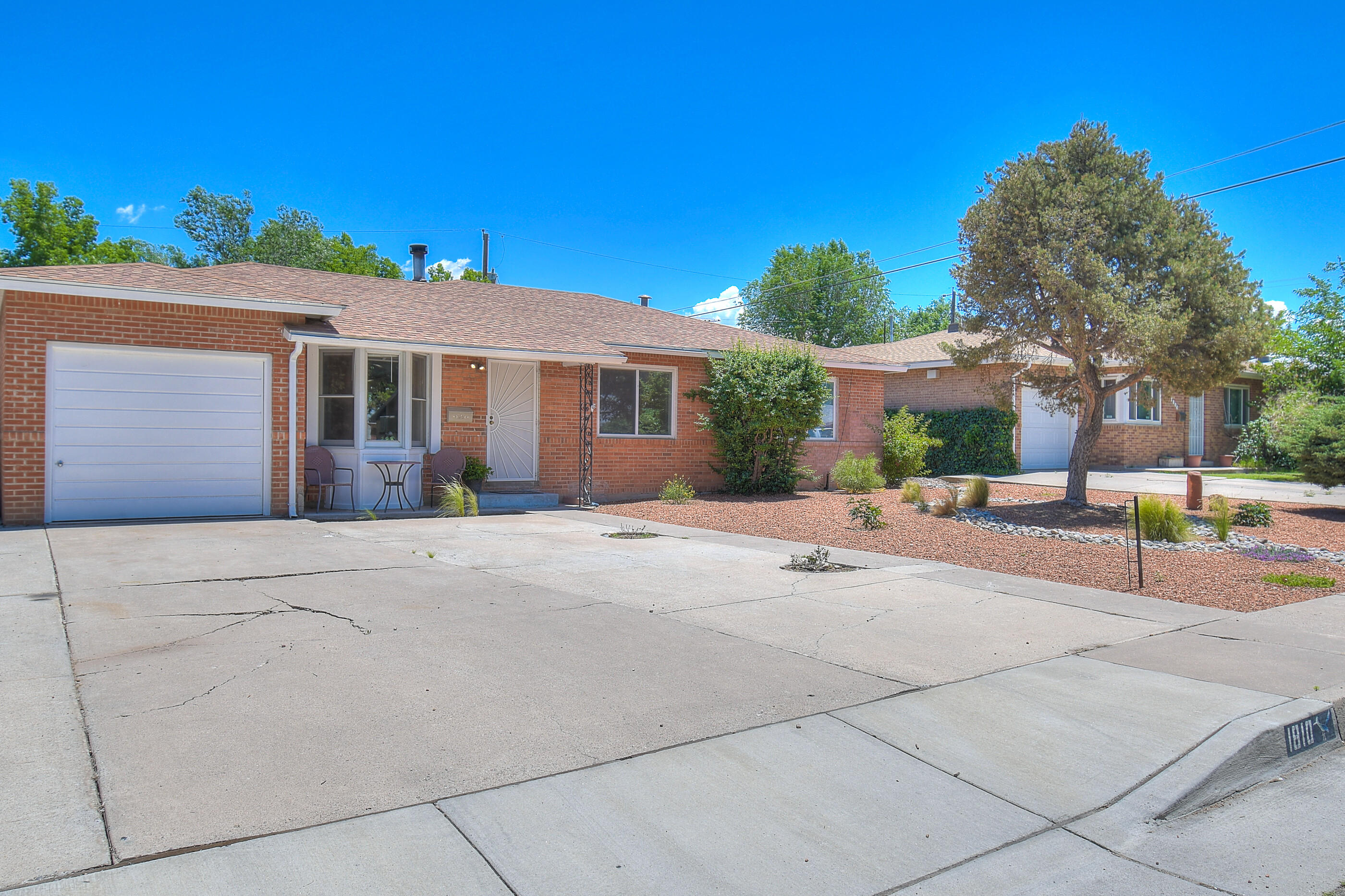 This 3 bed 2 bath home has fresh paint, new blinds, updated bathrooms and beautiful original hardwood floors. The living area boasts a lovely wood burning stove and open kitchen. Centrally located to parks, major roads and shopping. The backyard is huge and ready for your personal touch. New front landscaping adds to the curb appeal. A great find in the ABQ area!