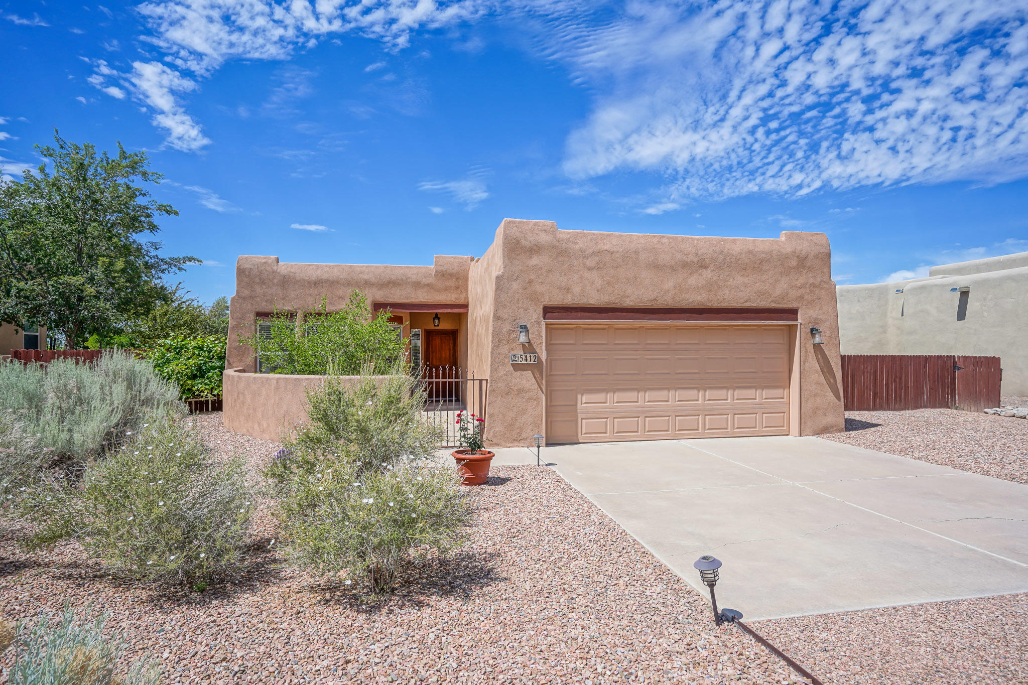 Open, Elegant, Renovated 'I live in New Mexico' Casa 1/2 acre w/ rustic sandblasted beamed wood ceilings, Kiva fireplace, niches, gated courtyard flagstone patio, covered back patio, wood great room floors. Gorgeous granite Kitchen counters & tile backsplash, stainless steel appliances, tile floors. Owner's Suite; double vessel sinks, granite countertops, jetted soaking tub plus separate shower. Second bath; granite countertops & vessel sink. Long views from backyard. No HOA! Backyard access, bring your RV, Boat, ATV! Home extensively updated in 2016: new septic, lighting, flooring, garage door, doors, paint, finishes, stucco and new HVAC. Prof. Landscape w/ drip irrigation. Lightly lived in, meticulously maintained. MULTIPLE OFFERS RECEIVED - SUBMIT HIGHEST & BEST THIS AM.