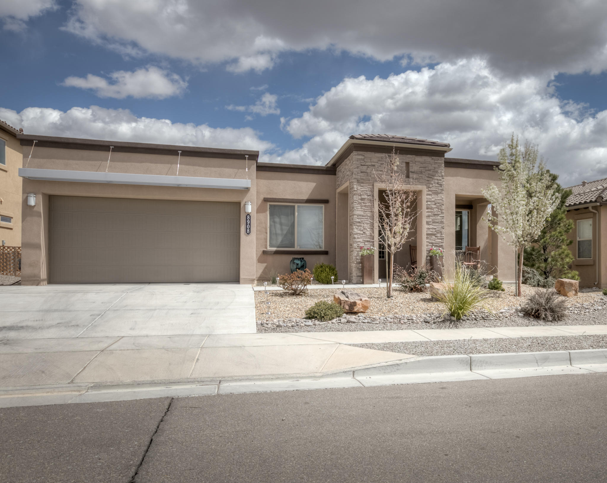 129,000 in Builder Upgrades!! This former DR Horton Model Home is a Build Green NM Silver Level offering energy efficiency throughout the year.  Situated on a view lot and quiet cul de sac street, this 2304 sf single story home has a spacious open floor plan.  The upgraded kitchen boasts quartz countertops, upgraded appliances, large island and a beverage center.  Large master suite includes a walk-in closet with a closet storage system.  Perfect for entertaining, the backyard is quiet and has its own gas fireplace.  There are too many special features to list!  Come see this amazing home.