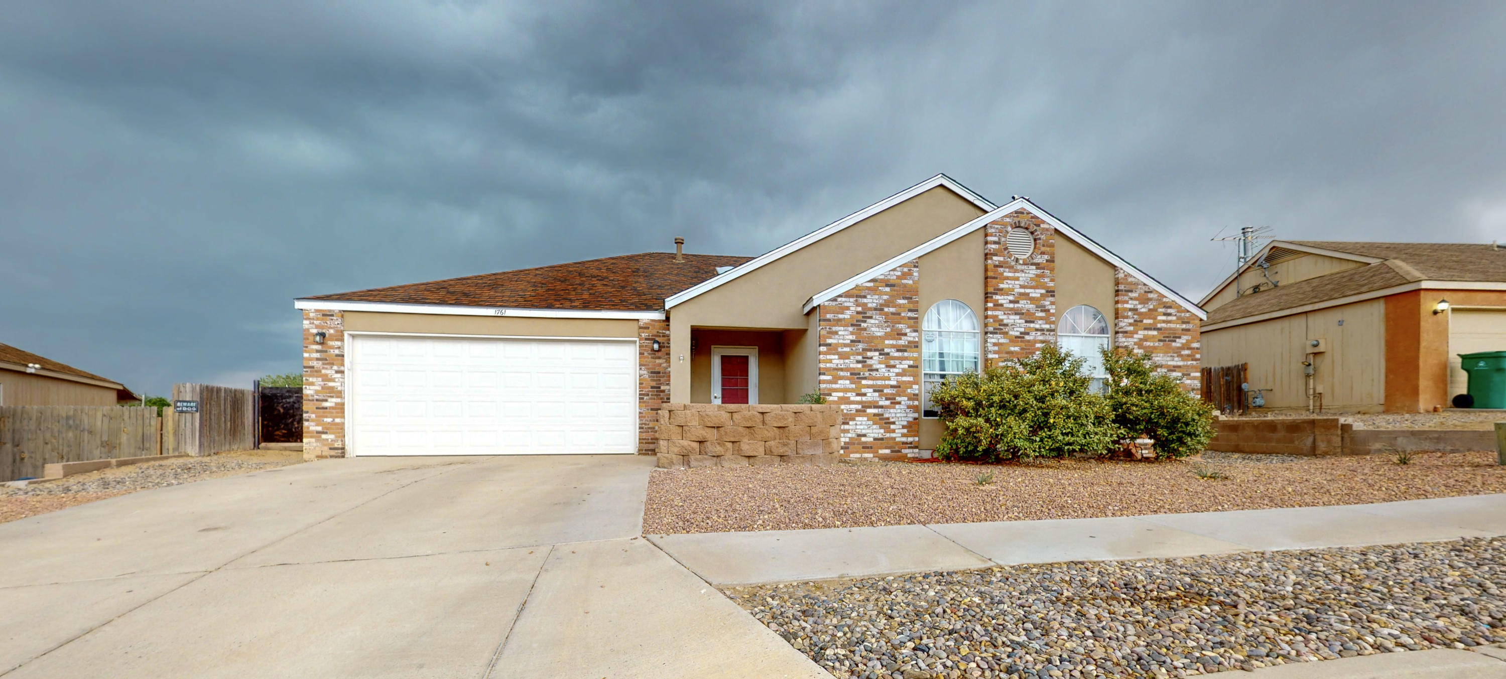 Lovely home in Rio Rancho! Granite countertops, newer cabinets with soft close drawers Home features large backyard with large Redwood deck and pergola, and storage unit. Master bedroom has separate his and hers closets with the master bath featuring double sinks and full bath! Living area has large windows and opens up to the large country kitchen!