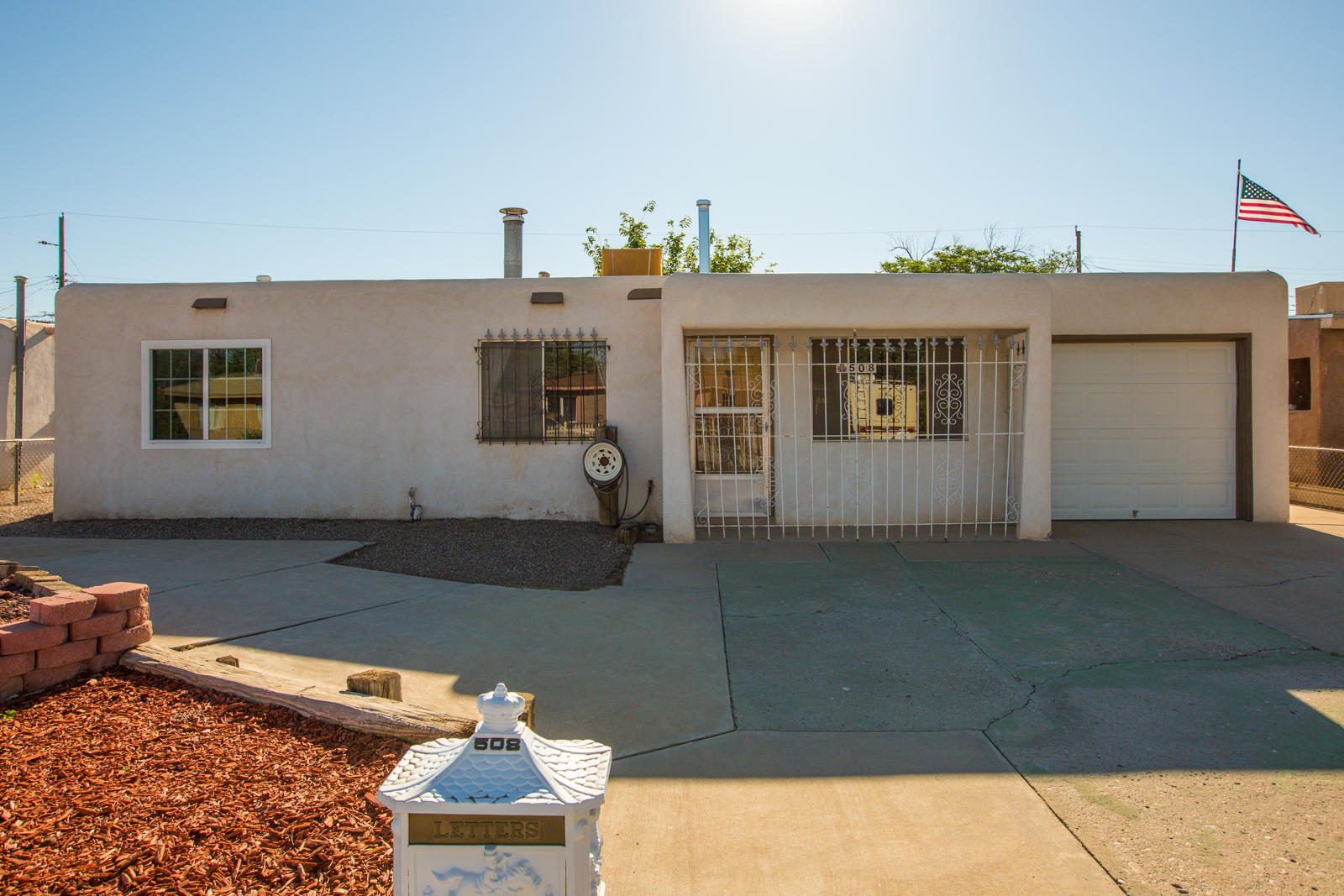 Great opportunity to own this house in a well established neighborhood. Convenient location just minutes from Coors & I40, the Bosque and Old Town! This two bedroom, one bath home features a spacious kitchen with newer appliances, cozy wood stove in the living room, one car garage with additional parking out front, and a gated driveway. A private pool in the backyard make it perfect for enjoying the summer!