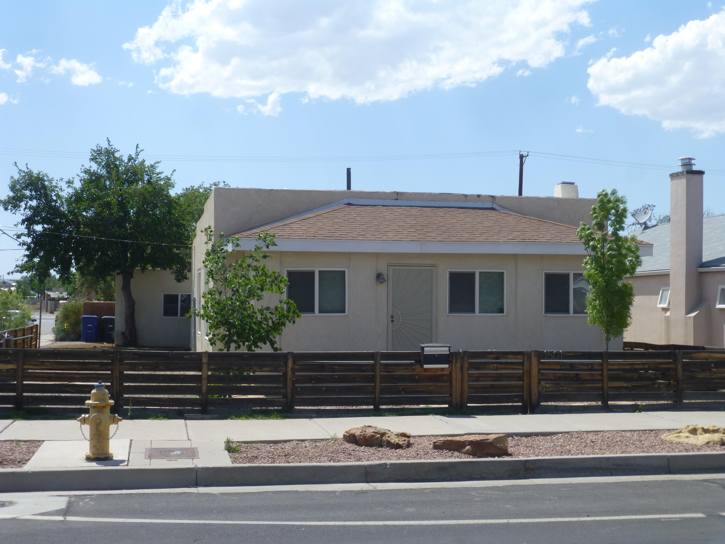 This one is a must see. Great home in a great location in downtown Albuquerque. Refrigerated air for those hot summer days. Nice backyard for entertaining. Stainless appliances in kitchen. Original wood floors. Newer TPO roof, Newer windows, New water heater.