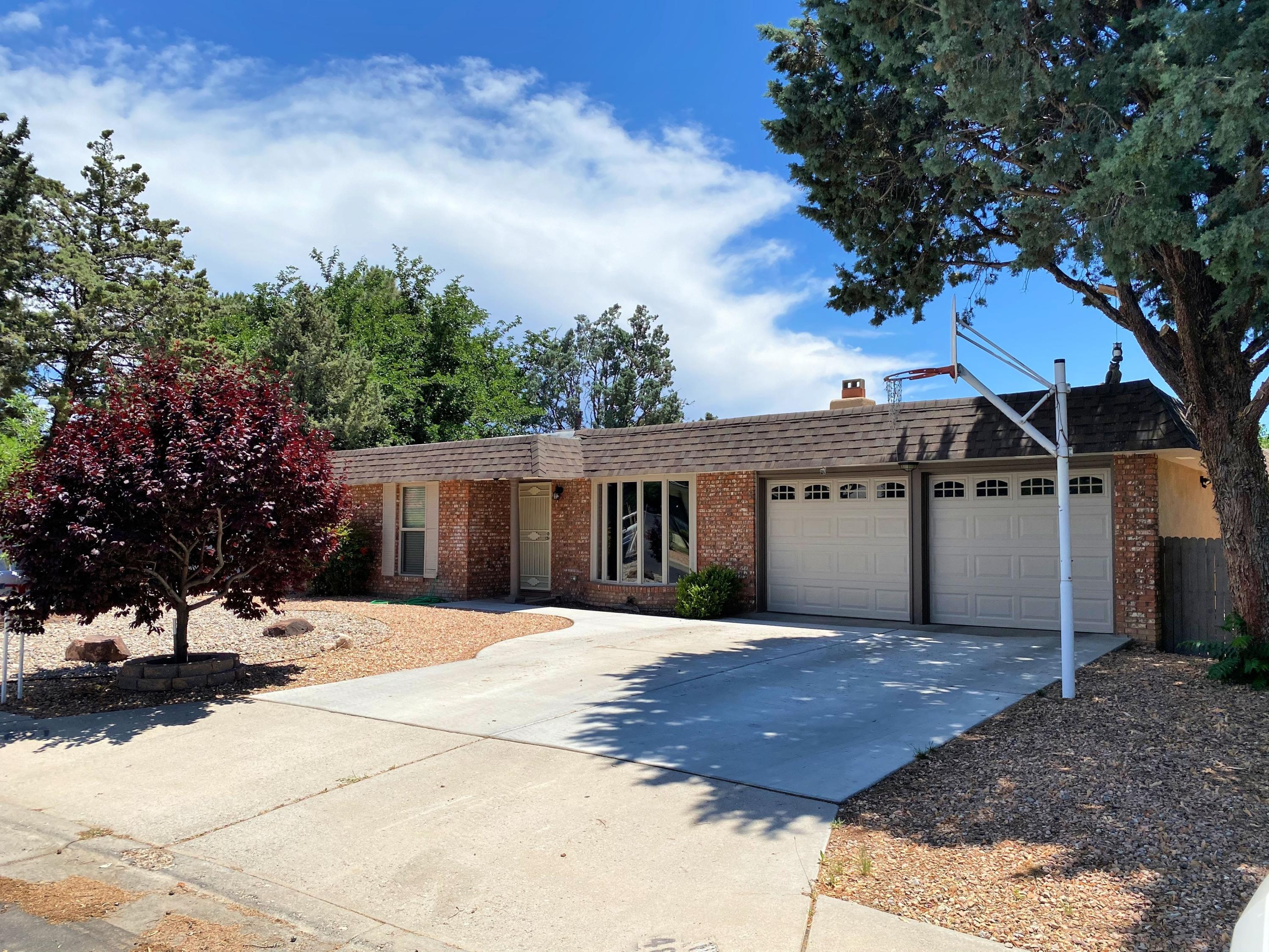 Fully updated home located near Arroyo Del Oso golf course! This beauty includes 2 living areas with an open floor plan perfect for entertaining! Updated kitchen with new cabinets, granite countertop & built in desk/work station. Living room area features a custom wood burning fireplace. Both bathrooms are completed updated. Come see this home today!!