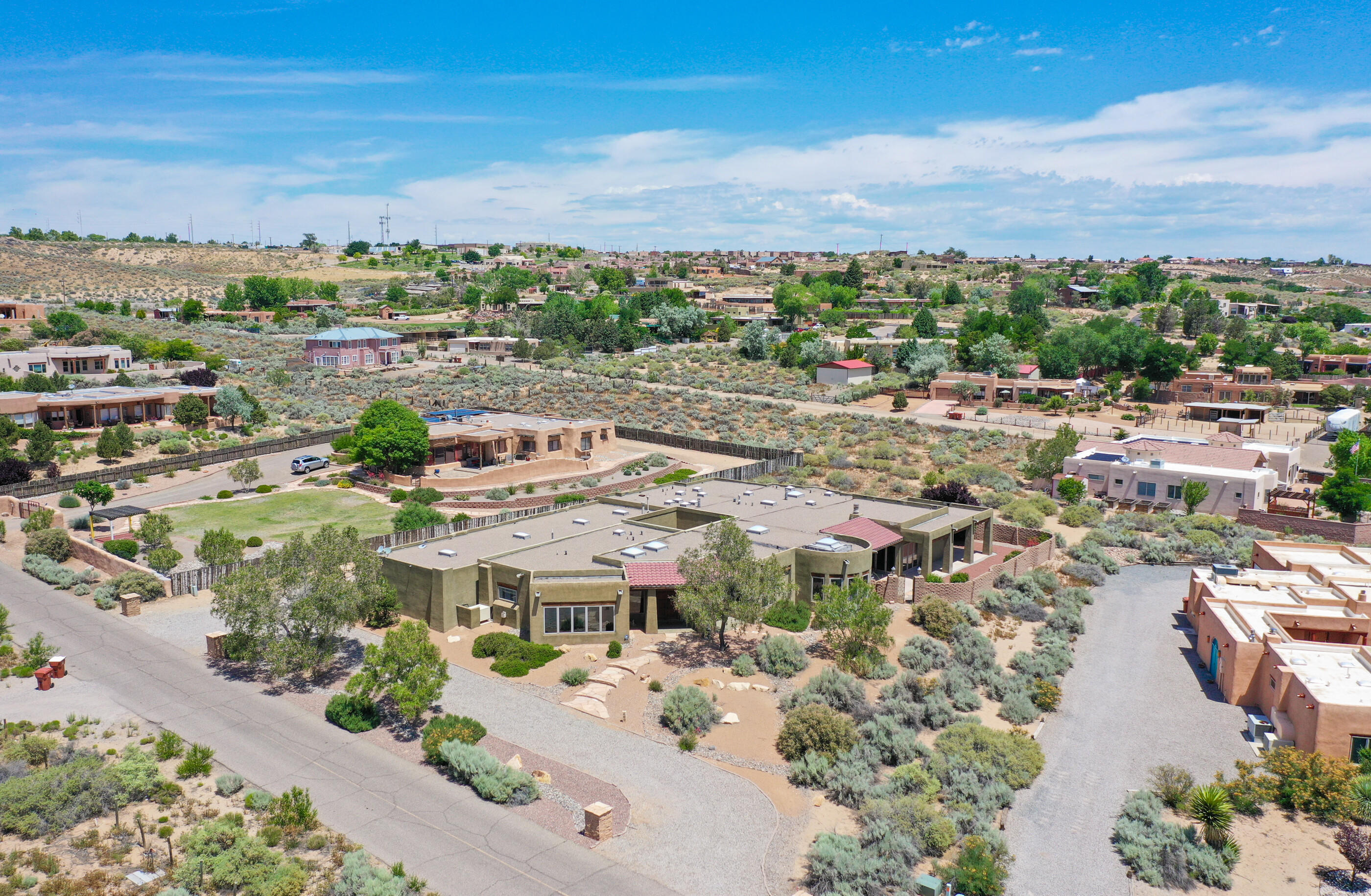 Stunning, custom built home on .89 acres in Corrales w/ beautiful mountain & bosque views! This sprawling floorplan has it all - formal living & dining rooms, gourmet kitchen, office/study, family room, media room, game/exercise room, master suite, 2 additional bedrooms each w/ own bath, courtyards, 7 car garage. Kitchen has large island w/ 2 five-burner cooktops & prep sink, SS appliances including 2 double ovens & a sub-zero refrigerator, 3 pantries, large breakfast nook. Master retreat offers sitting area, 2 gas log fireplaces, his/hers vanities, 2 separate showers, large jacuzzi tub, his/hers walk-in closets, dressing/massage area. Interior & exterior courtyards provide plenty of space for outdoor entertaining. See attached additional property info for list of amenities and features