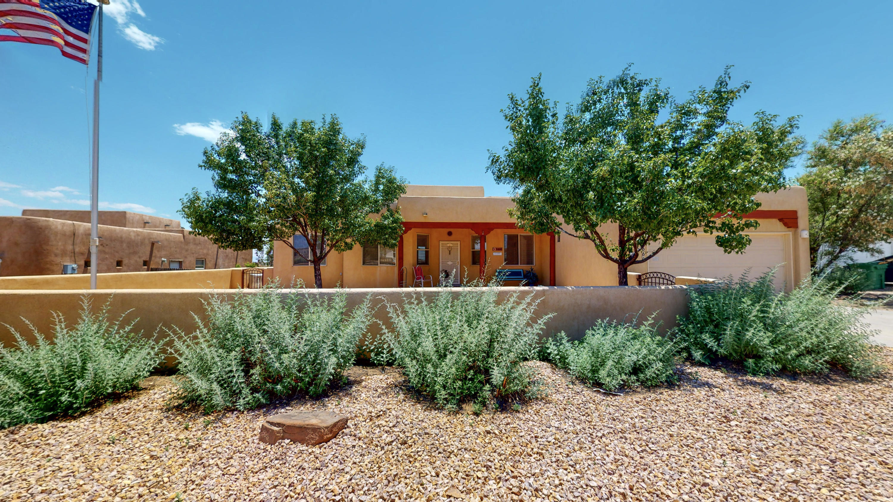 Gorgeous single story custom home sitting on .50 acres in Rio Rancho with mountain views! Open living/kitchen area with gas kiva fireplace, vaulted ceilings with vigas, lighted nichos, beautiful wood laminate flooring, ceiling fans, and skylights. Large kitchen with tons of storage, walk-in pantry, bar seating. Formal dining room, and bonus room/ office space! Master suite with his/her sinks, Jacuzzi tub, and separate shower and walk-in closet. Refrigerated air! Walled backyard with large covered patio to soak in the views! close to shopping, dining, and Rust medical center! Schedule a private showing or take a virtual walkthrough tour today!