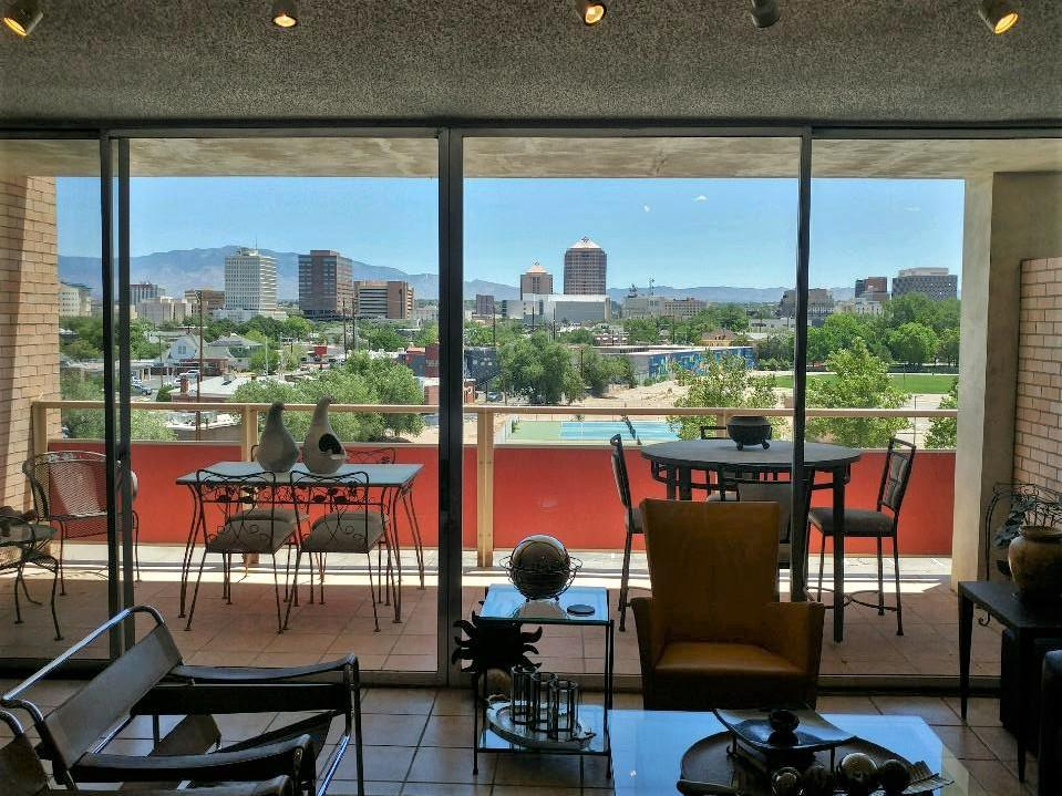 Lovely remodeled unit with Downtown and Sandia Mtn VIEWS, featuring full-size Park Plaza kitchen with granite counters, Frigidaire stainless steel appliances, natural wood cabinets. The bedroom features a newly-installed custom Elfa Classic Closet system, also has Downtown and Sandia Mtn views! With tiled floors throughout, a fully mirrored living room wall, and a full balcony overlooking the city lights, this 826sf unit is light, airy and feels huge--a beautiful way to enjoy Sandia sunsets. The HOA dues cover all utilities, one reserved covered parking space, pool, exercise room, and so much more--see attached Facilities/Amenities list. See MatterPort Virtual Tour! Laundry Facility close to unit. Potential Buyers required to have pre-qual/POF; observe COVID-19 protocol.