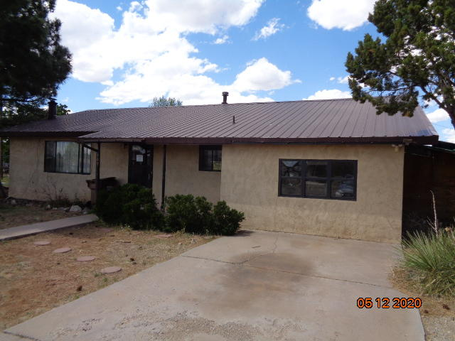 Nice 2/3 bdrm 2 bath home on 3 city lots, close to schools shopping and restaurants,  only 34 miles to Albq close to freeway access as well come on out and enjoy the  simpler small town living also includes a out building that could be used for storage or workshop in the rear fully landscaped well worth the look.