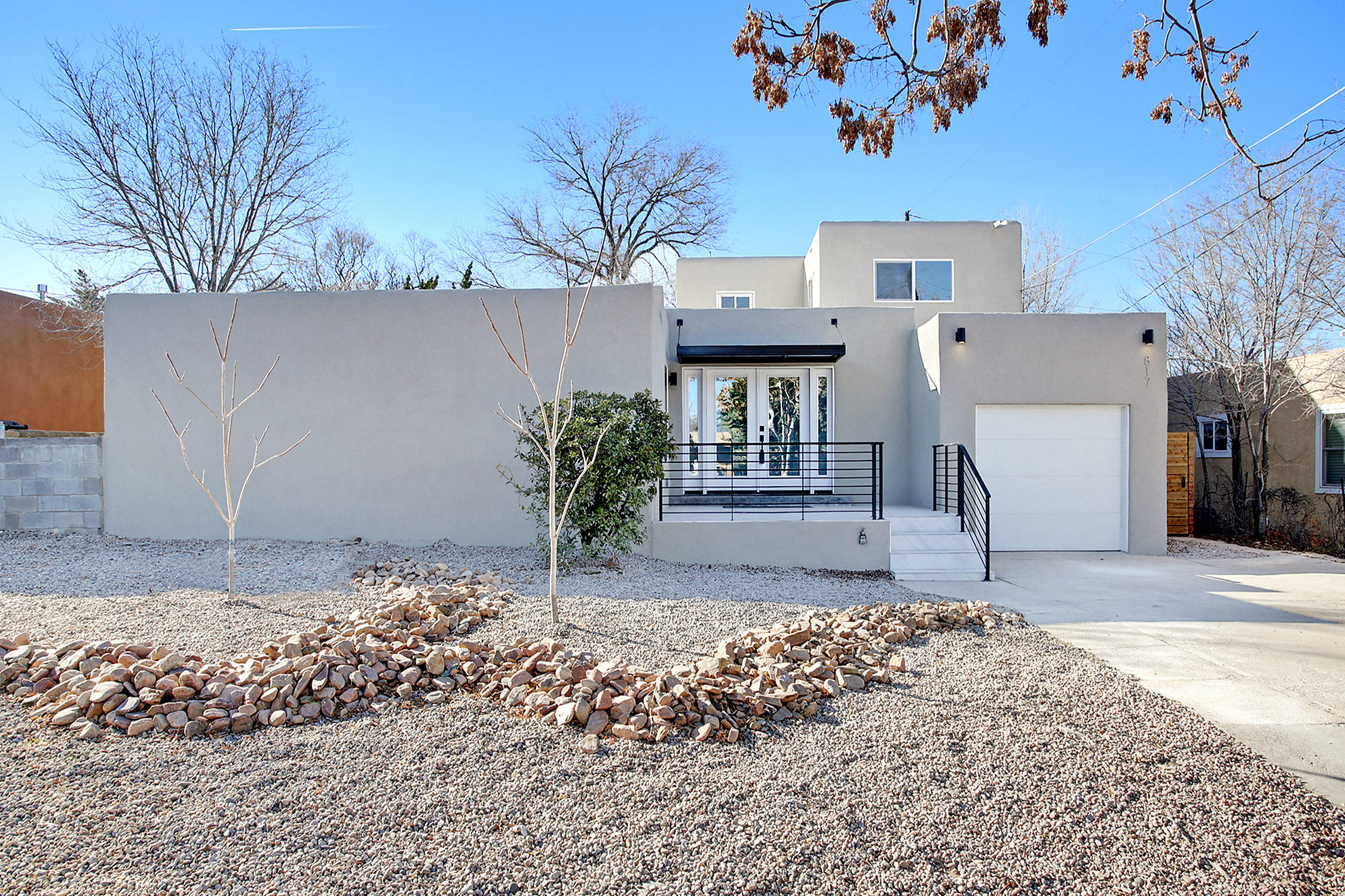 This Apex design property in UNM North is like a new home, & has been extensively updated into a contemporary show piece. An amazing light filled great room at the center of the floor plan, flows into the open kitchen with a corner fireplace, & eat at island. Quartz counters, new cabinets, stainless steel appliances, including a 5 burner stove, pantry & subway tile backslash from counter to ceiling. French oak wood floors throughout with large format tiles in the wet areas. Owner's suite on main level has a large walk in closet with a barn door. Luxurious bath with floating under lit double sinks, jet tub, separate shower & water closet. 2 bedrooms upstairs with loft office space. Home boasts a new TPO roof, hot water heater, thermal windows, refrigerated air & heat. Backyard with pergola.