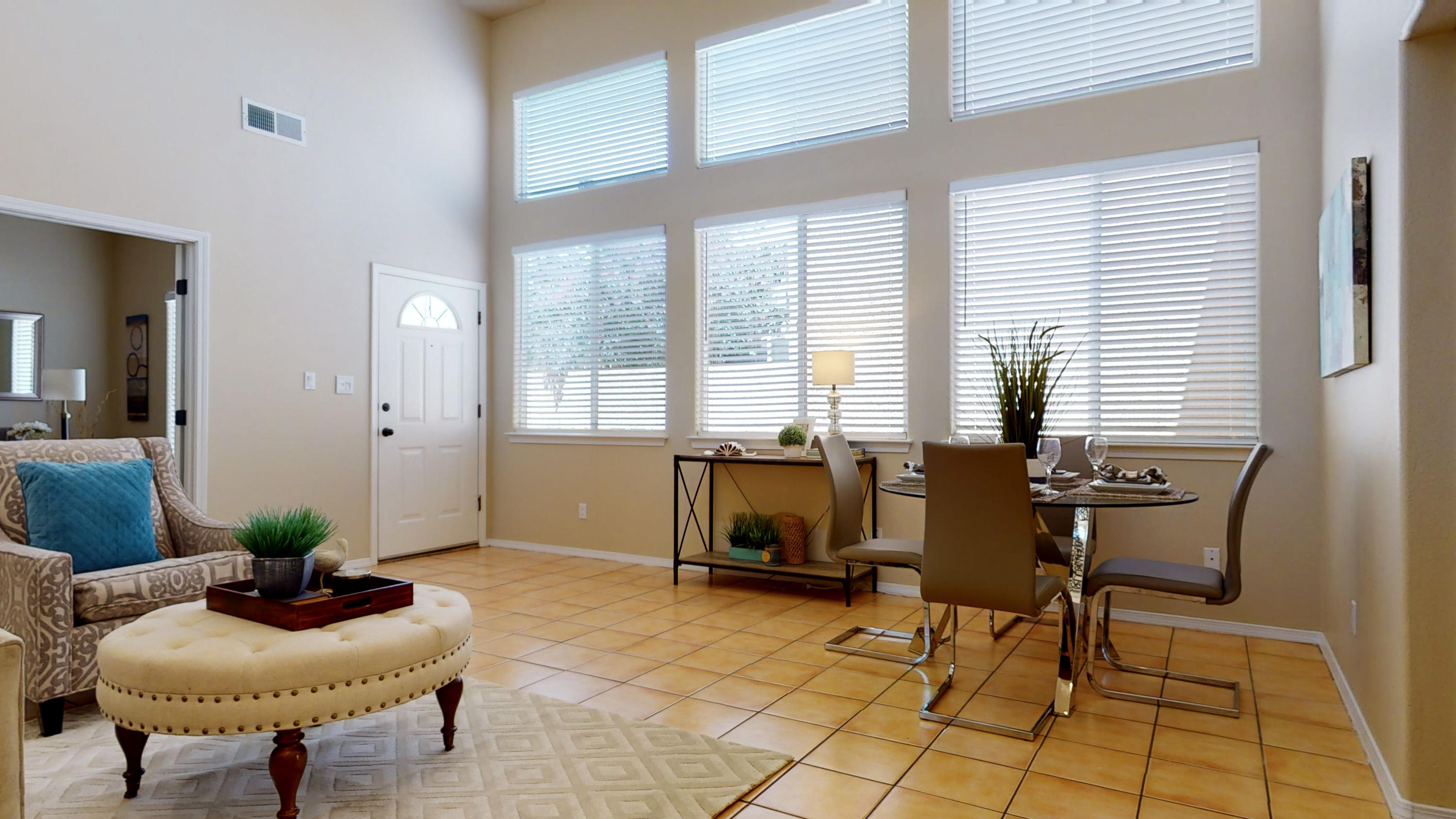 Multiple Strong Offers Received - Submit Highest and Best. Rare find, lovely single story townhome, private and secure, move in ready, 3 good sized bedrooms, soaring ceilings, clerestory windows, tile & laminate flooring throughout. Owner's suite has sitting area and sliding glass door to private grassy backyard oasis with shade and mature landscaping. Brand new heating / cooling combo unit. Stunning French white framed doors on bedroom #3 could also be an office, exercise or 2nd living area. Coveted neighborhood and location! Shops and services abound nearby.