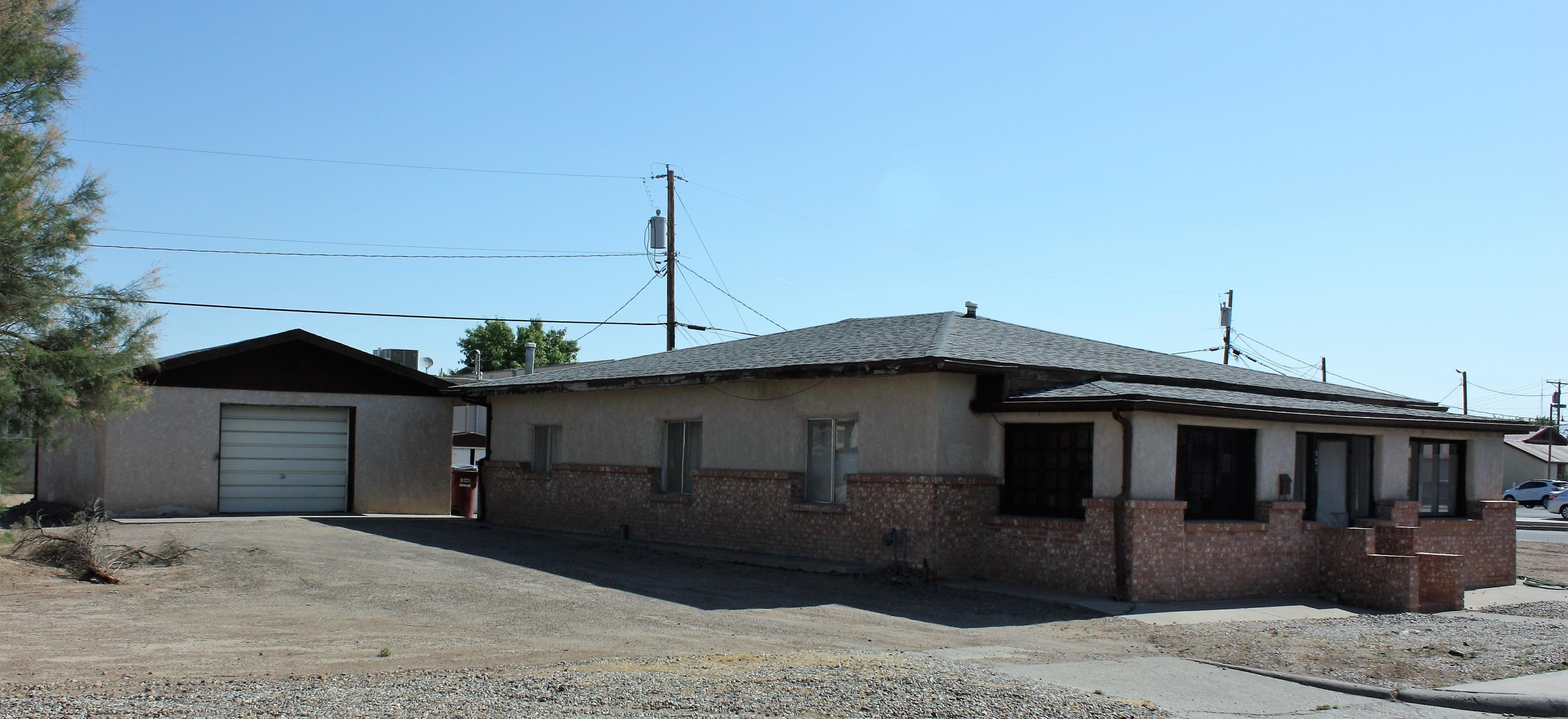 Home sits on the corner of three big city lots in the heart of Belen. Large oversized detached garage.  Home is in need of work and repair.  Lights and water are currently on.  Commercial properties are across the street and in the back.