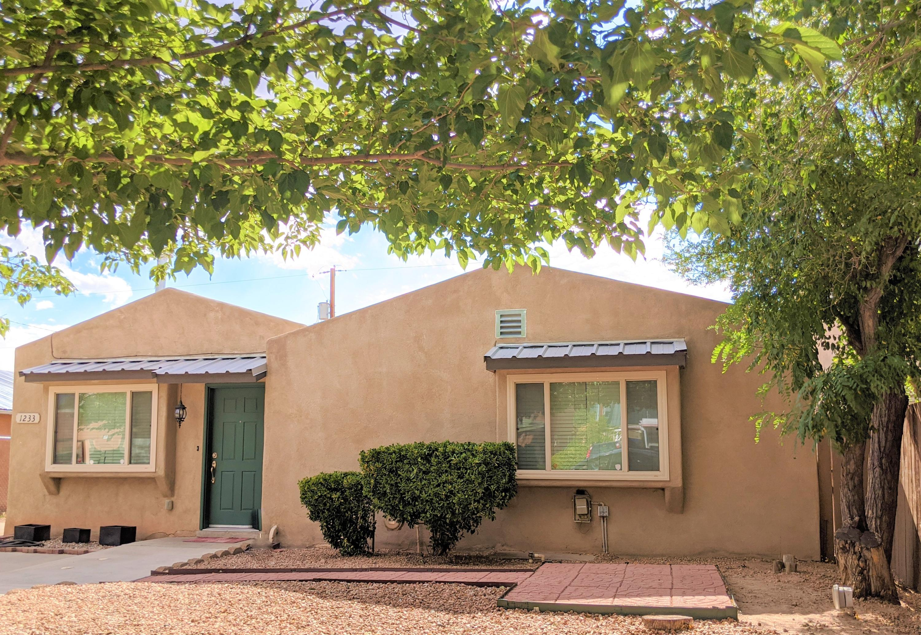 Unique 3 bedroom 3 bath split floor plan with double Master Suites (one with a private entrance!) in the Wells Park Neighborhood.  Tons of cabinet space in this bright kitchen. The spacious master spa bath includes a roll in shower and double door entry! Interior bedroom doors are gorgeous solid wood, and are at least 36'' wide, which makes the home wheelchair friendly! No Carpet in this home!  Floors are original hard wood, wood laminate, and ceramic tile.  The vinyl clad double pane windows cut down the utility bills. Master Cool like evaporative cooler to keep you chill in the summer! Cozy gas fireplace to keep you snug in the winter! Large bedrooms for this area of town. The roof with metal accents was tuned up this Summer.