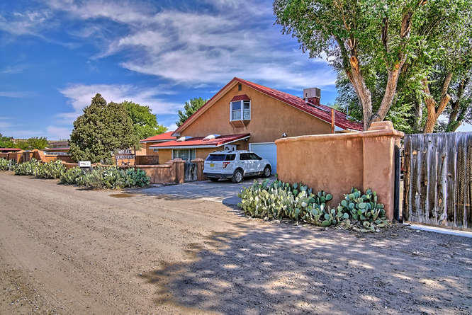 This wonderful Corrales home has a Northern New Mexico/Ranch twist and is ready for a new owner. This wonderful home is spread out on a gorgeous .93 acre lot with beautiful mature trees, lots of grass and lots of room for everything you want. You'll enjoy many home amenities including the 3 large living areas, 4 spacious bedrooms, 2.75 baths, soaring cathedral ceilings, stainless steel appliances including commercial grade range with infrared boiler, wood metal clad windows, natural travertine flooring, oak cabinets with tile counter tops, large kitchen island, skylights throughout, lots of closet and storage space. Don't forget the 24'X100' warehouse/workshop or kennel and the 2 car carport.  This home is hard to beat and is in move in condition. Don't miss out on this great home!