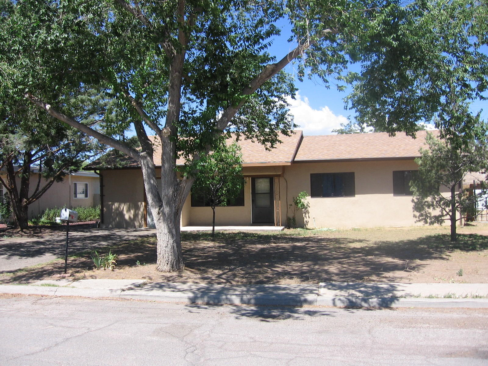 Very well maintained home near NMT campus. 4 bedrooms, 2 baths, French doors going into family room which has a pellet stove, new kitchen floor and good looking carpet.  Ceiling fans. Fenced backyard with storage shed. Appliances included.  At this price this exceptional house should sell quickly...  so make an appointment to see today!