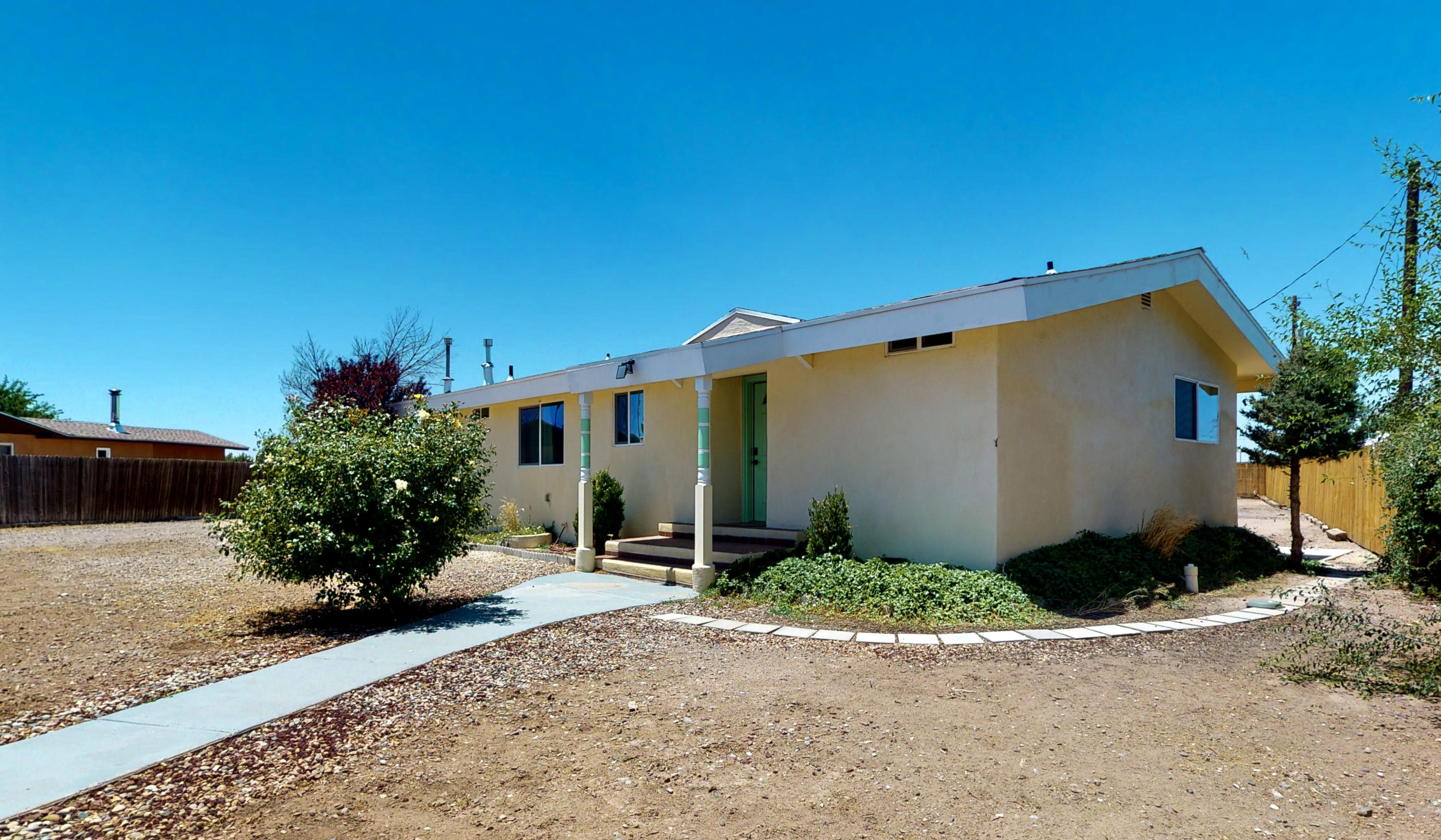 Hurry! You do not want to miss this newly remodeled North Valley home!  Situated on a huge lot in a charming neighborhood with Mountain views! This home is a must-see with so much attention to detail in every room! French doors of the living room lead you to a huge backyard ready for your creativity and ideas! The private master suite features a new master bathroom with double sinks and a walk-in closet! This home is gated with backyard access for privacy and added security!  Close to Dining, Balloon Fiesta Park, and quick access to Alameda Blvd. Schedule a private showing or take a virtual walkthrough tour today!