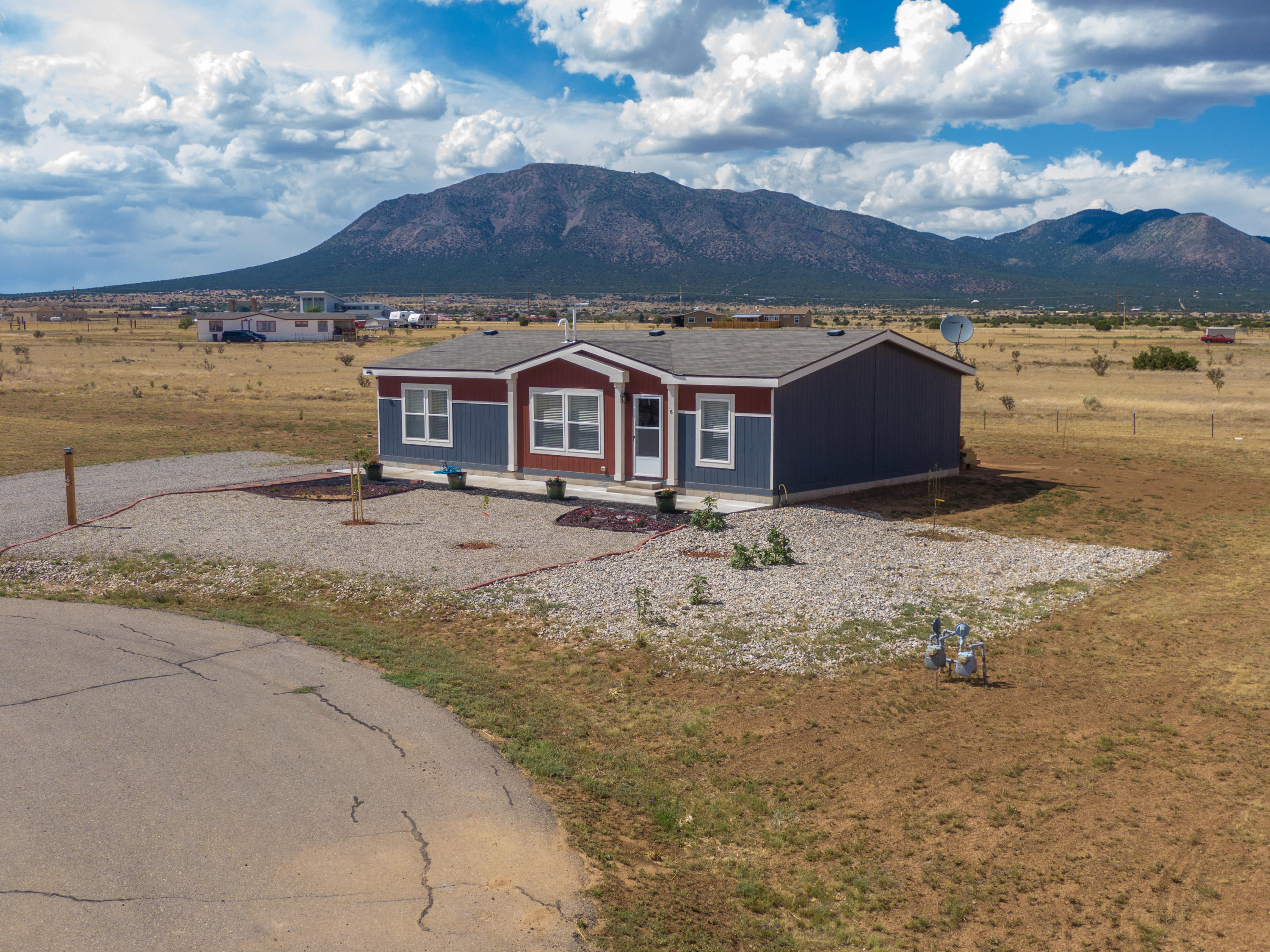 Welcome to this Move-in Ready, 1-Owner, 2017-Built, Single-Level Country Retreat in the East Mountains! Nestled on 1 Full Acre on a Quiet Cul-de-sac, 6 Cob Court offers *Refrigerated Air*, an Open-Concept Floor Plan, and Breathtaking Mountain Views for Miles! This Clean, Modern Kitchen features a Huge Island, Gas Range, Stainless Range Hood, and Pantry. Your Master Suite presents Double Sinks, a Large Garden Tub, Separate Shower, and Walk-in Closet. Take in Stunning Mountain Views on your Newly-Built Deck in the back! Horses Welcome! Community Water + Natural Gas. Make an appointment to see this Like-New Home today!
