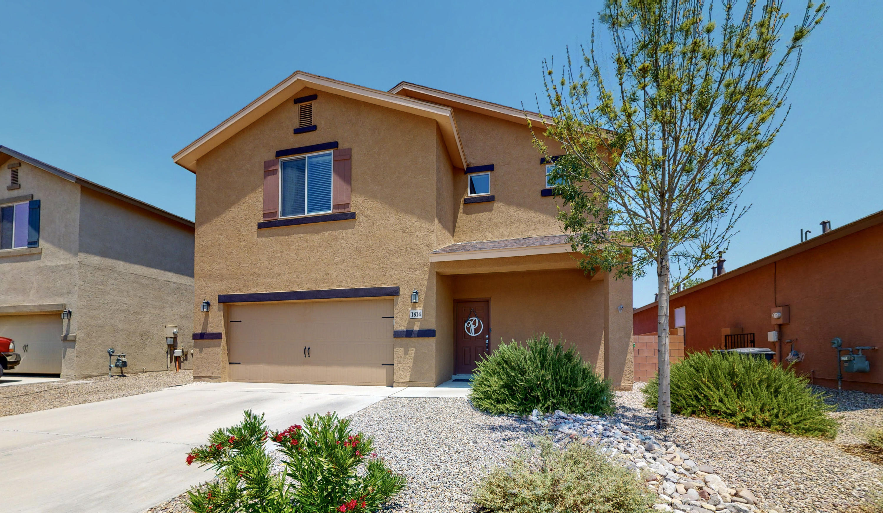 Located in the high range community! Don't miss this like-new LGI home with four-bedrooms, three-bathrooms and 9 ft tall ceilings!  This home features updated modern lighting throughout, refrigerated air,and is landscaped front and back! The must-see Kitchen boasts Granite Countertops, Under-mount Stainless Steel Sink, Stained Maple Cabinets in a rich Nutmeg color w/ crown molding, gas Range and Large Island! Luxurious Master bathroom features double sinks, separate garden tub and shower. Close to Santa Ana Star Center, Rio Rancho Aquatic Center, and Rio Rancho Middle school. Schedule a private showing or take a virtual walkthrough tour!