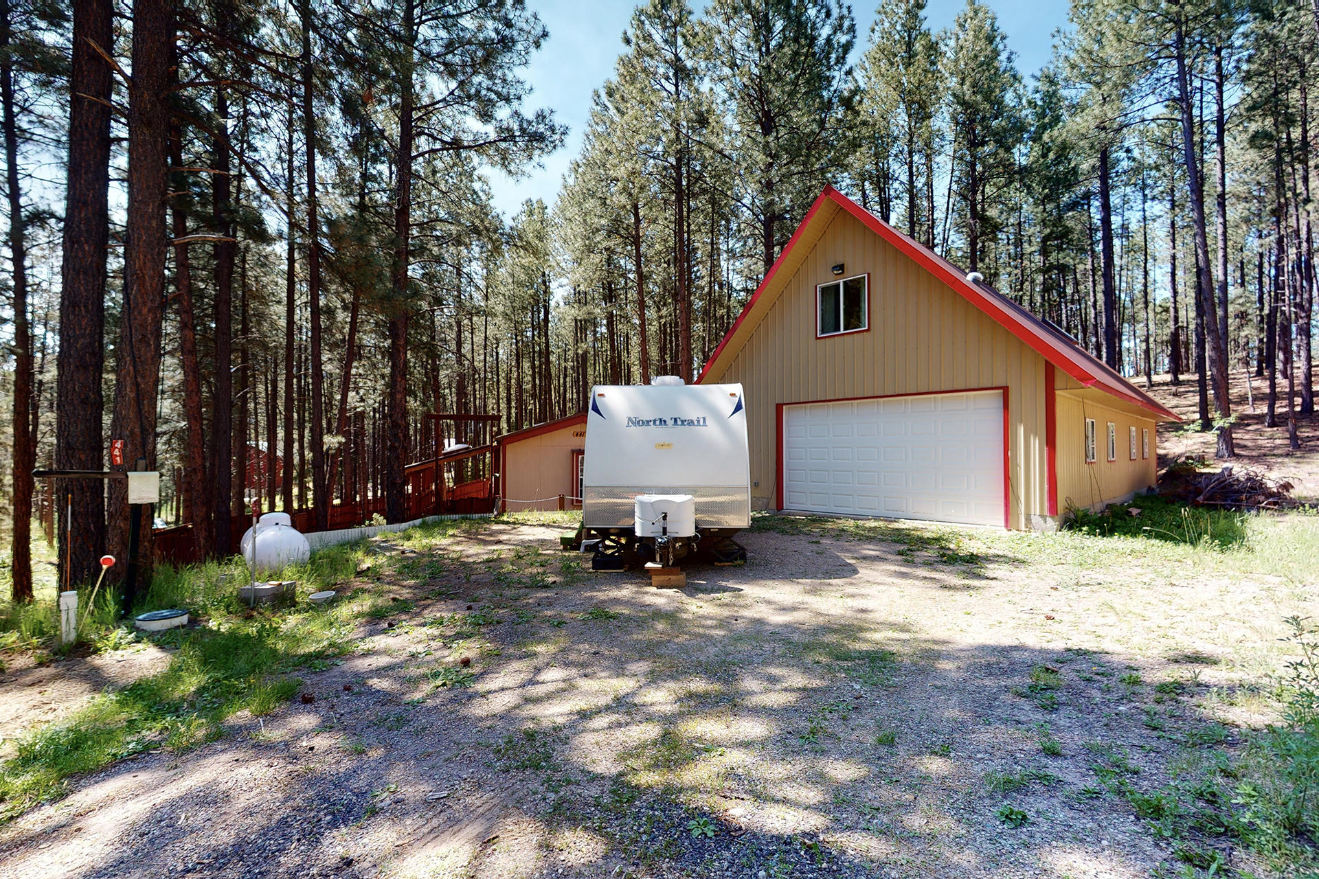 Are you looking for a place that provides serenity yet lots of activities close-by?  Look no further!  This home in Jemez Springs is literally a wildlife Mecca! Right down NM-4 you'll find Elk Viewing and Las Conchas Trail for hiking and viewing wildflower habitat!  Also right down NM 4 is the Valles Caldera National Preserve, a ski-walking area and the Bandelier National Monument. Now get ready to relax in your remodeled manufactured home sitting on a 1 acre lot.  Relax on the front Trex porch and enjoy the peacefulness. 4-bay 26 x 50 foot finished dream garage w/ versatile space on second floor for studio/office w/private balcony. Property Overview - Nicely remodeled manufactured home on a permanent foundation occupying 1 acre. New flooring. * (See full description in MLS Documents