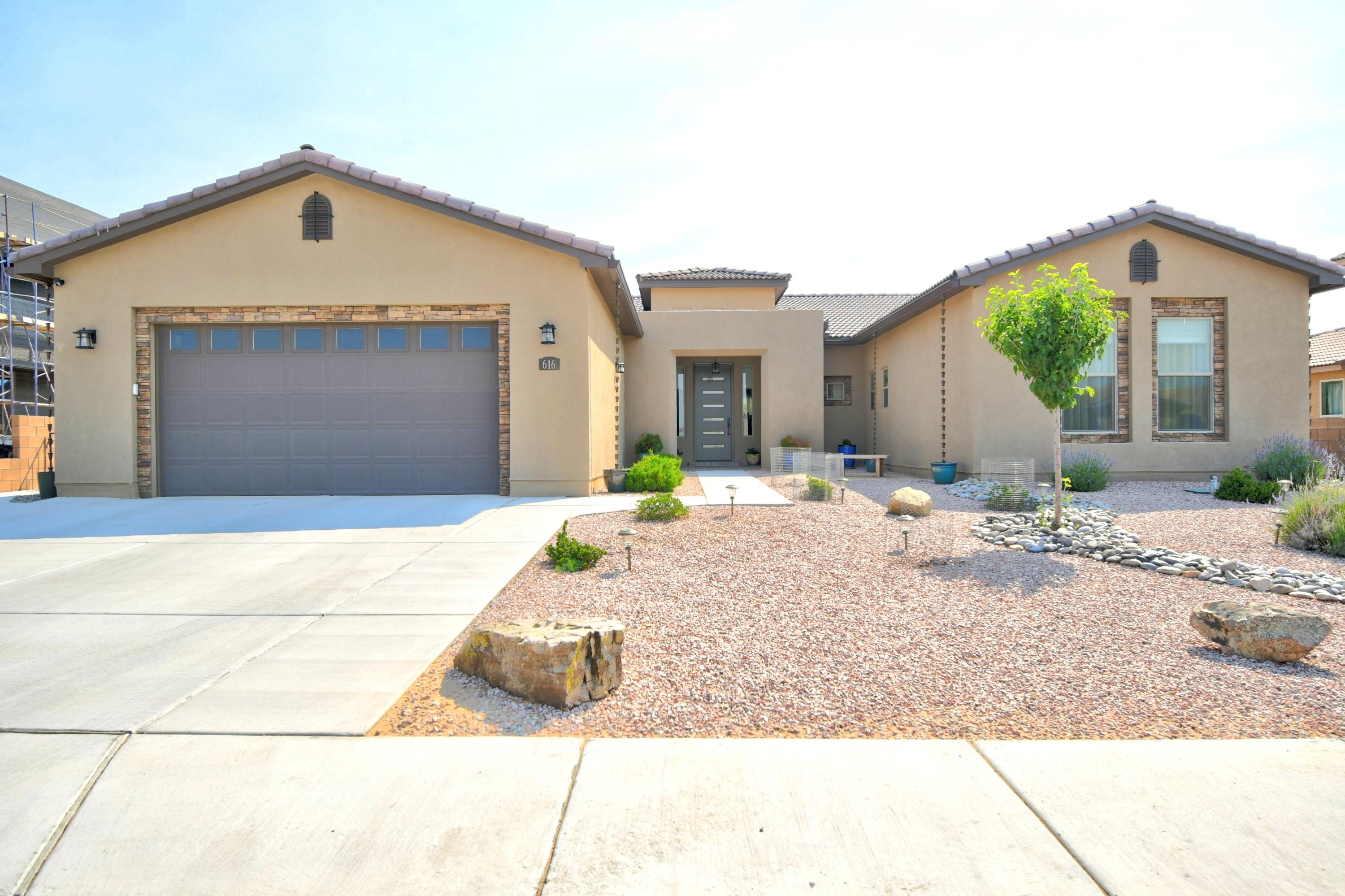 Beautiful single story custom home in the gated community of Ocotillo. Your greeted at a custom 8 ft front door. Enter into a big living room with an open floor plan with the kitchen and large breakfast nook. Enter the large Master bedroom with walk in closets for his and hers and beautiful master bath.  Master bath has 6ft tub and large shower room. In the kitchen, quartz counter tops with all stainless steal appliances and a walk in pantry. Garage has a custom 9ft door and will fit 3 cars, 2 cars in tandem. Up graded lights throughout.