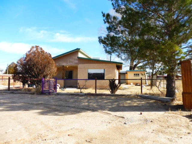 1046 Adobe/frame 2 bedroom home .37 acres In the heart of Los Lunas/Commercial potential. Off frontage road, close to Rail Runner Express/Transportation Center and I-25 Interchange.