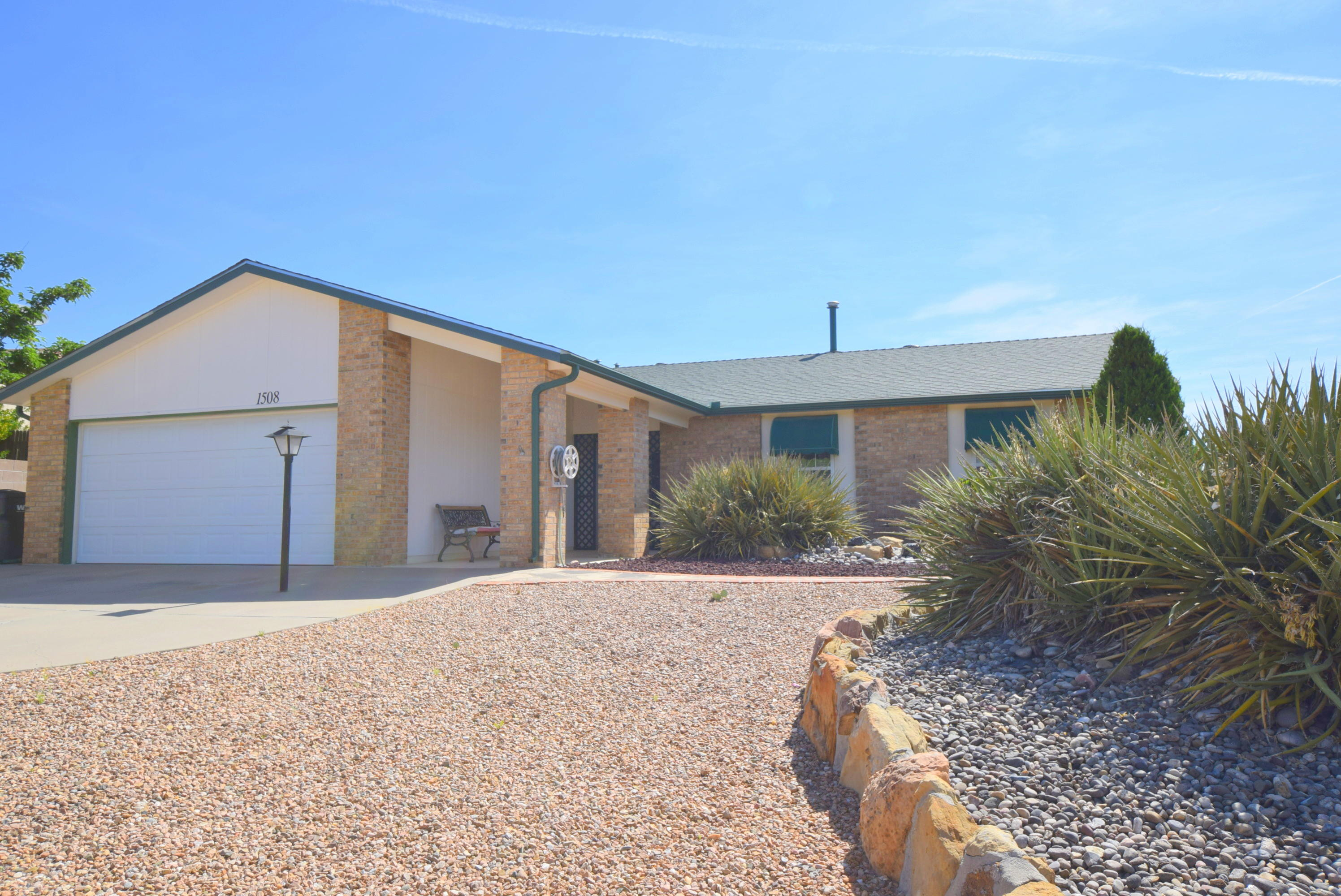 One owner and well cared for Ranch one story home on quiet street, 3 blocks off NM 528.  Huge great room off back of house with 2 large Anderson picture windows showcasing magnificent mountain and city views and fireplace, 20 x 20 outside deck off the greatr oom to enjoy the same views.  Dining room with a pellet fireplace and 3 flat screen wall mounted TVs that convey along with huge mirror that stays.  All appliances convey including the washer and dryer.  Storage shed with electricity stays.
