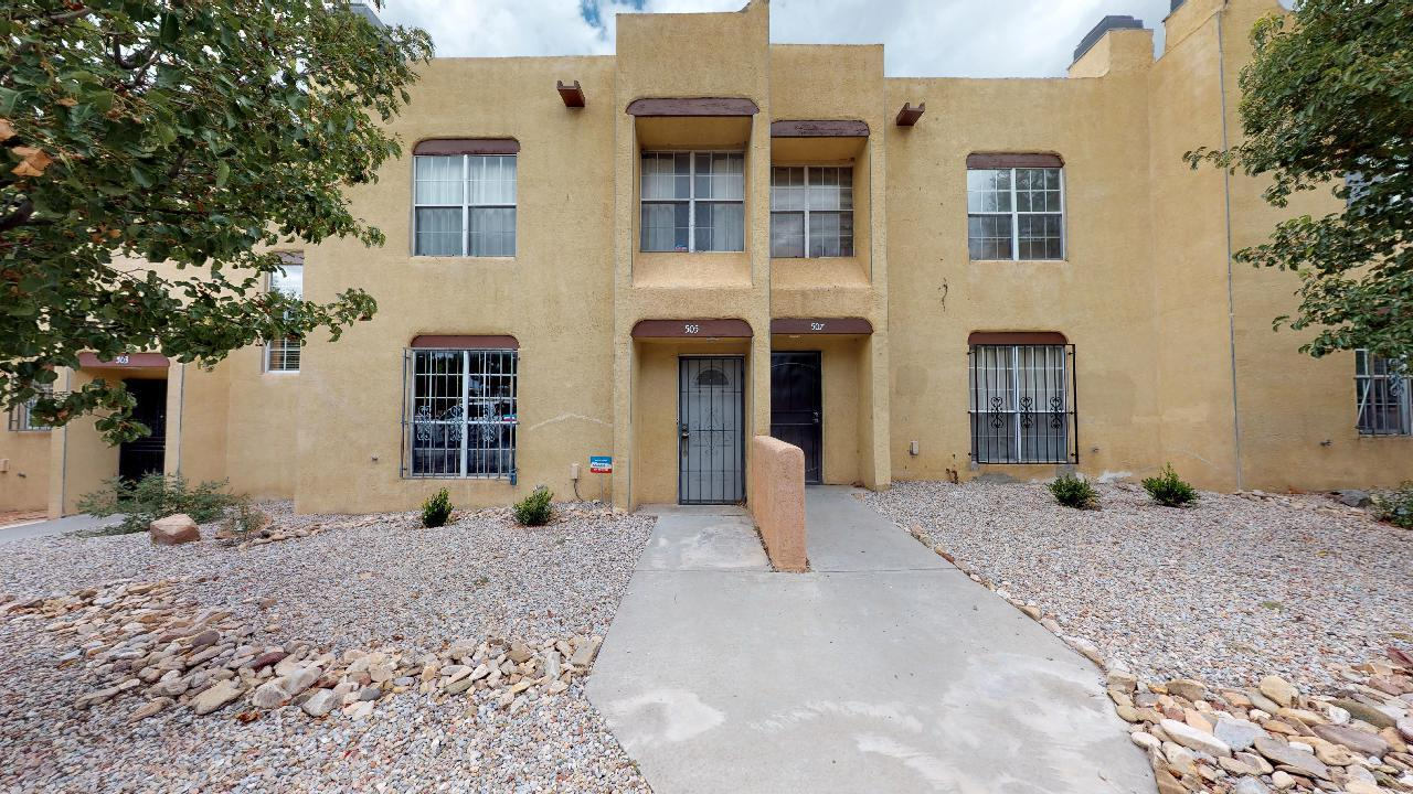 LOCATION!!  This wonderful Townhouse is located in the heart of the city and is conveniently located near UNM, Downtown, Knob Hill, Old Town, CNM, Museums, Restaurants, Shopping, Schools and just about everything.  Close to the public transportation hub and just minutes to freeway access.  This light and bright home features a full sized detached two car garage, a private back yard with raised flower beds, beautiful flooring through out, a cozy wood burning fireplace and a New TPO Roof.  An absolute gem.  Here's your chance to live in one of the most desirable neighborhoods in town.