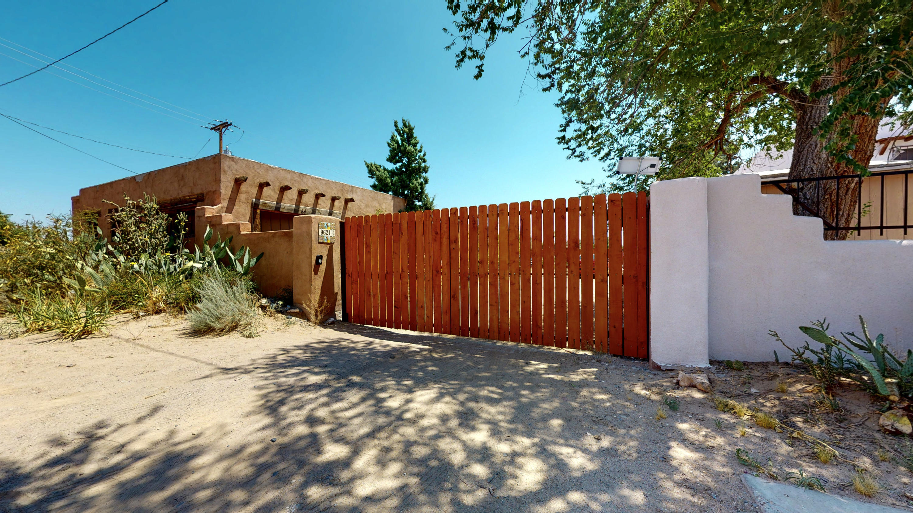 One of the Original Adobe Homes along Route 66. This 3 bedroom 1 bathroom home is fully enclosed and has lots of space for your creativity. 1 car garage with tons of storage ready for your finishes. Sellers upgrades include: bathroom, kitchen & dining room extension, security bars, wood fence with metal gate. This home is being offered WHERE-IS / AS-IS. Schedule a private showing or take a virtual walk-through tour today!