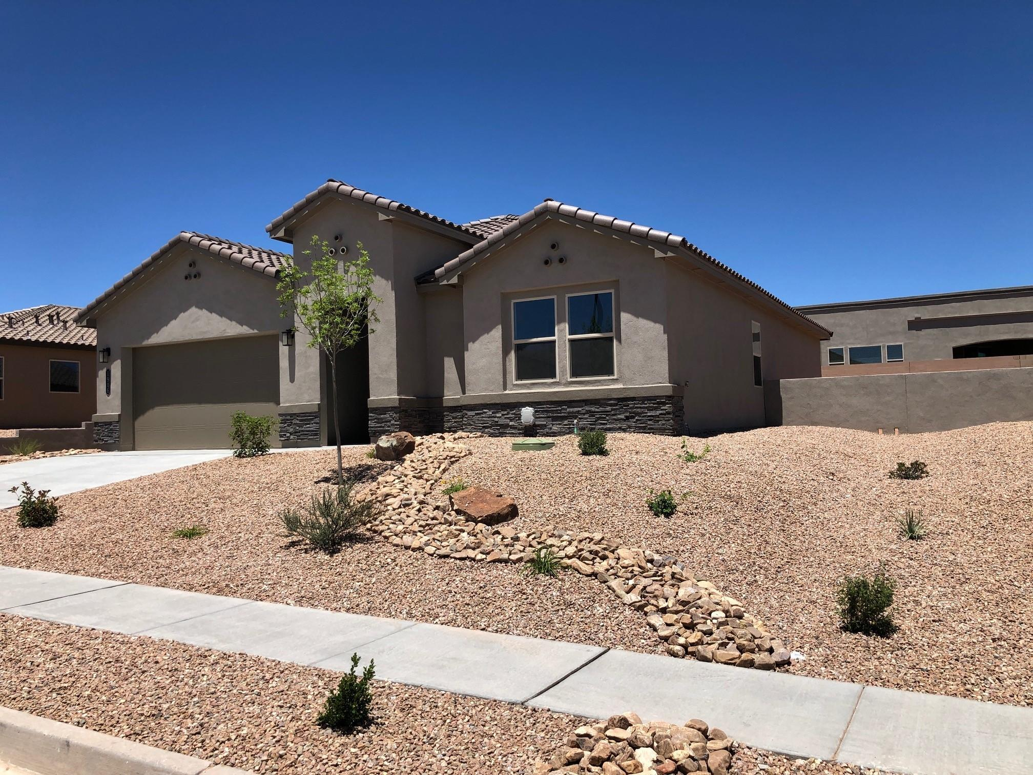 Imagine, living the good life in Mariposa, a 6,500 acre community with 2,300 acres of open space, nature trails, community center, indoor and outdoor pools, fitness center & parks. Mariposa is a community in Rio Rancho with extra large lots and space to breath! This wonderful home features the luxuries of a custom home. A chef's delight kitchen with large granite island stainless Whirlpool appliances (gas cooktop & built in wall oven & microwave). Home has 18'' ceramic tile throughout, except bedrooms. Fireplace in family room to entertain. Home feels much bigger, light & bright with 8 ft doors and windows looking out to large covered patio. This is a SMART HOME and New Mexico Green Built Certified. Stop by model home to see furnished home with similar features.