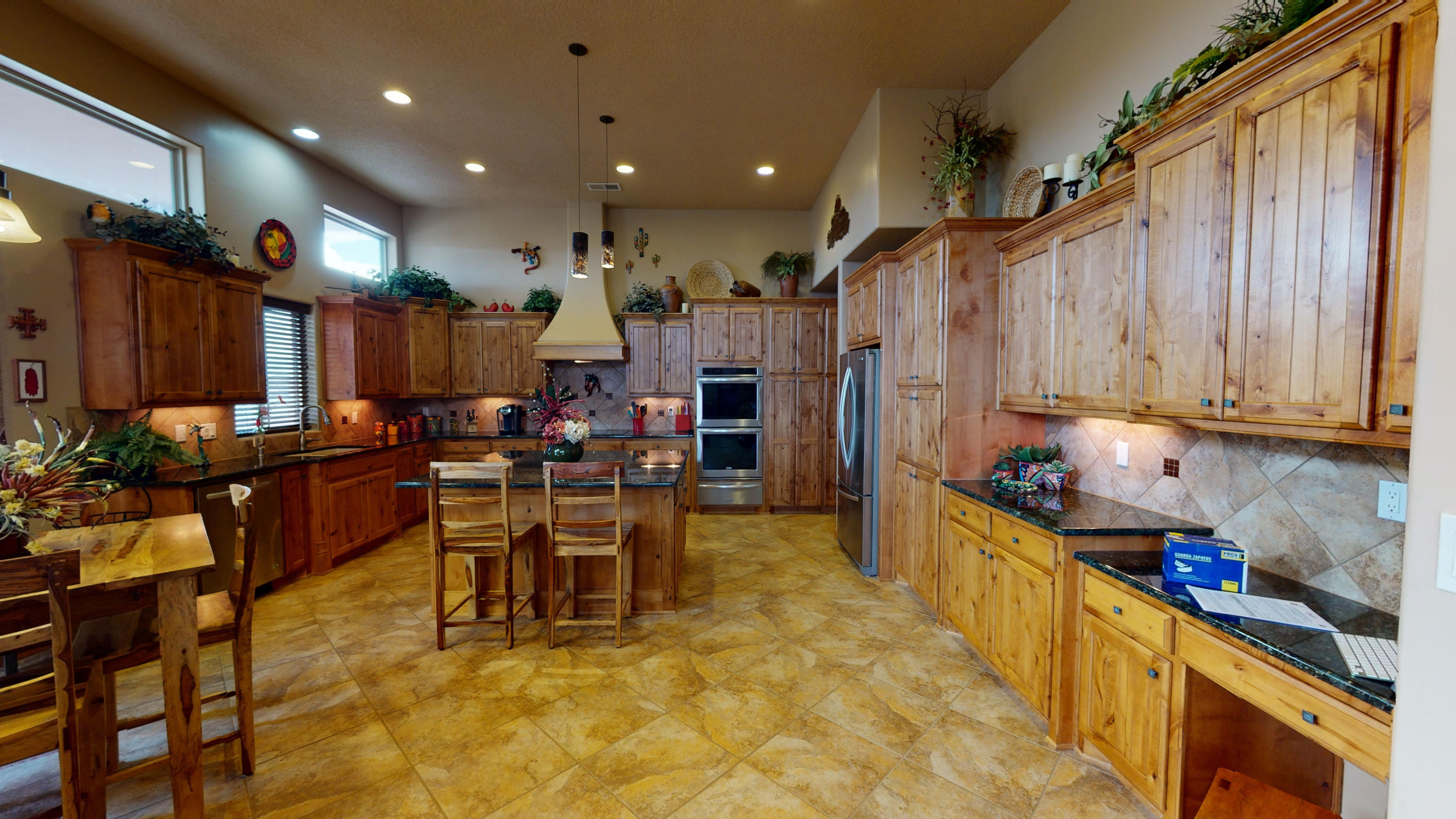 Extremely hard to find exquisite property in the heart of Rio Rancho.  ZERO spared on all int and ext upgrades and amenities... too much to mention, BEST chef's kitchen you have ever seen, that opens up to entire home.  Barely lived in 6.5 years old, majorly upgraded, that shows brand new.  Over the top indulgence amenities - then ADD forever mountain and Rio Grande Bosque views! When compared: corner private lot, views of everything, dream kitchen, MSTR suite w large walk in his/her clsts,  private view deck, 4 CAR GRG and 1000 SQFT RV GRG-FULL HOOKUPS, 2 Custom Gates and security courtyard, 2 Water Features and Extra land!  Feels and looks like BRAND NEW HOME.  Excellent... nationally ranked schools and major conveniences just minutes away.   SEE FULL FEATURE SHEET AND 3D VIDEO!