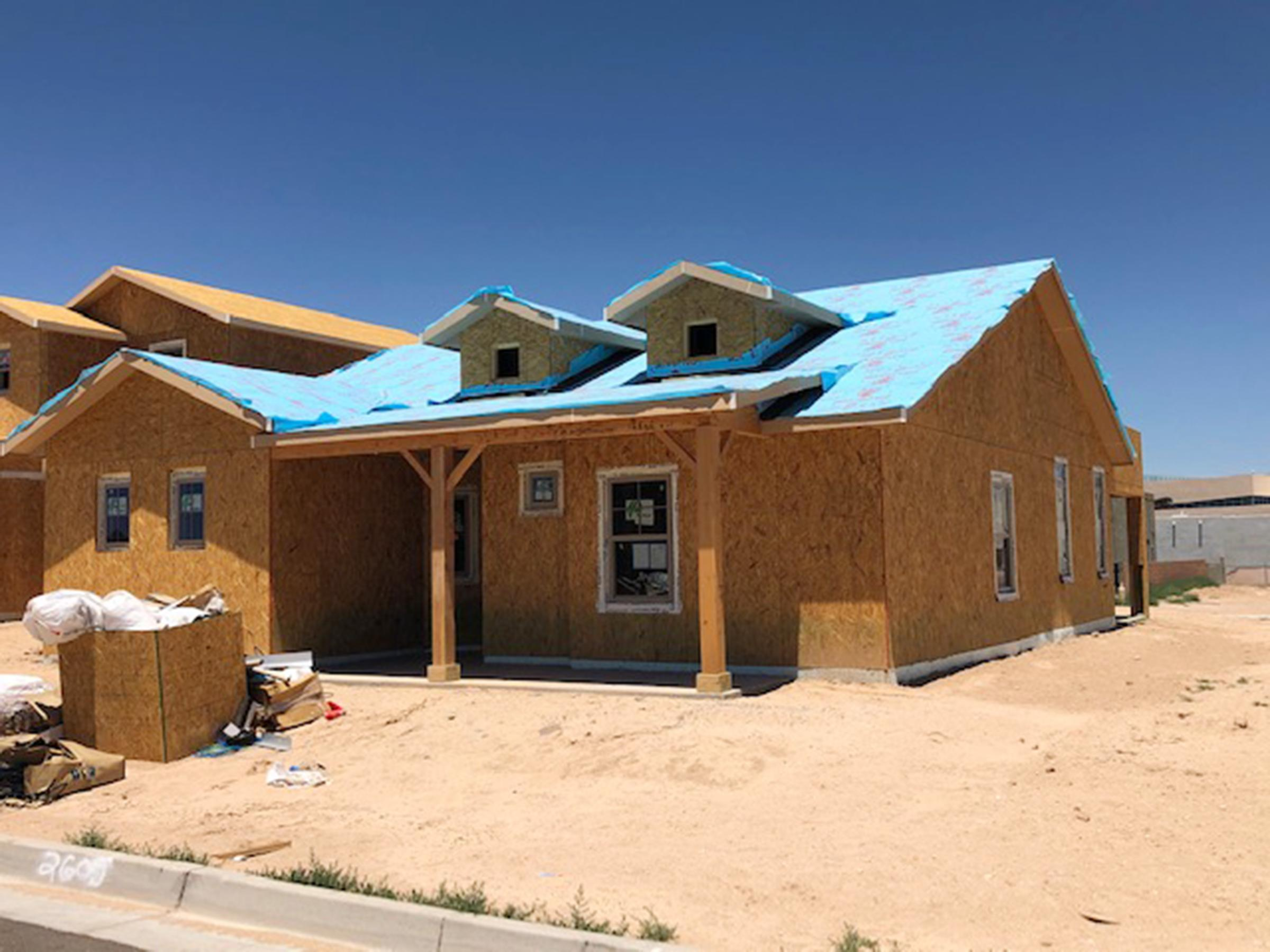 The Pilsner by Abrazo Homes offers and innovative design with rear garage concept located in The Mesa Del Sol Community.  Home is  currently under construction.