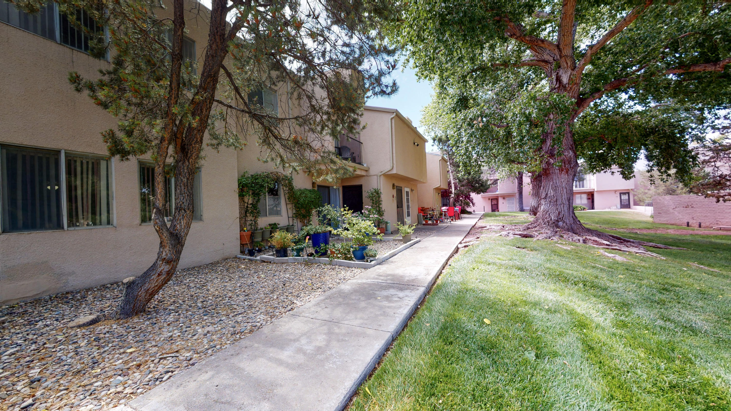 Welcome to Unit A-1 of Sandia Plaza Condominiums! This 1 bedroom 1 bathroom condo has 2 living areas, a covered carport parking spot, all appliances that convey, and one of the few units with a laundry in the home. HOA fee covers water/sewer/trash as well as Exterior of the Residence, including Roof and Common Areas/Greens, Community Pool (currently closed), Club House, on-site Laundry and Building Insurance. Come see it today!