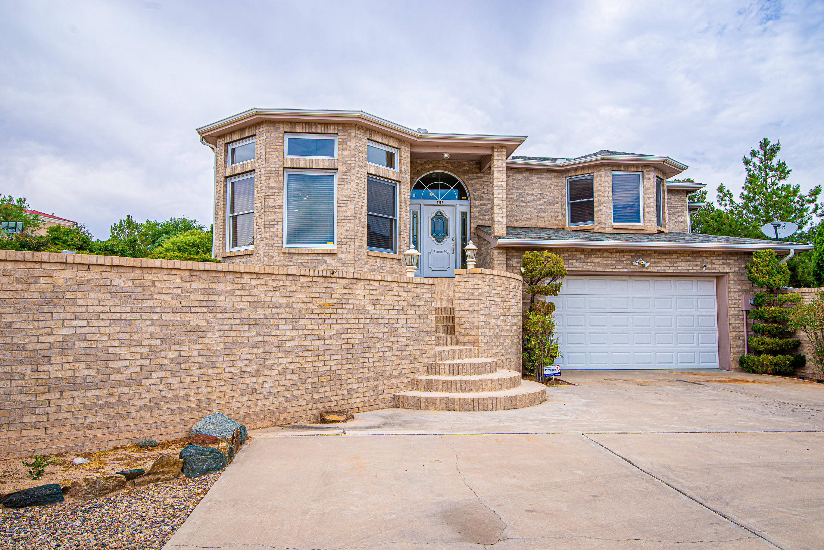 What a great chance to own this beautiful brick home in a desirable community! Views from this property of the Los Lunas valley are absolutely breathtaking. The space in this home is set up well with two separate living rooms and dining rooms. Outside you will find a large back deck with a built-in grill, fire pit area and a in-ground swimming pool -- perfect for entertaining! Other great features include a large master suite, updated bathrooms, new carpet, built-in security cameras, central vacuum system,  extra storage/crawl space and bathroom in the garage! Call to schedule your showing today!