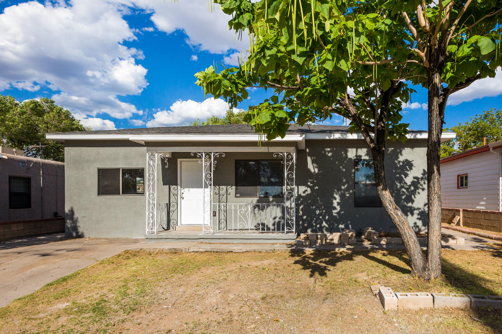 Welcome to this stunning property located across from UNM Football Stadium. This 3 bed 1 bath has recent updates including roof, AC, Water Heater, flooring, paint, and more! Home also includes workshop in the backyard for storage/art studio. Quartz countertops, remodeled bathroom, tile in laundry and kitchen, this home is ready for a new owner! Come see this property today!