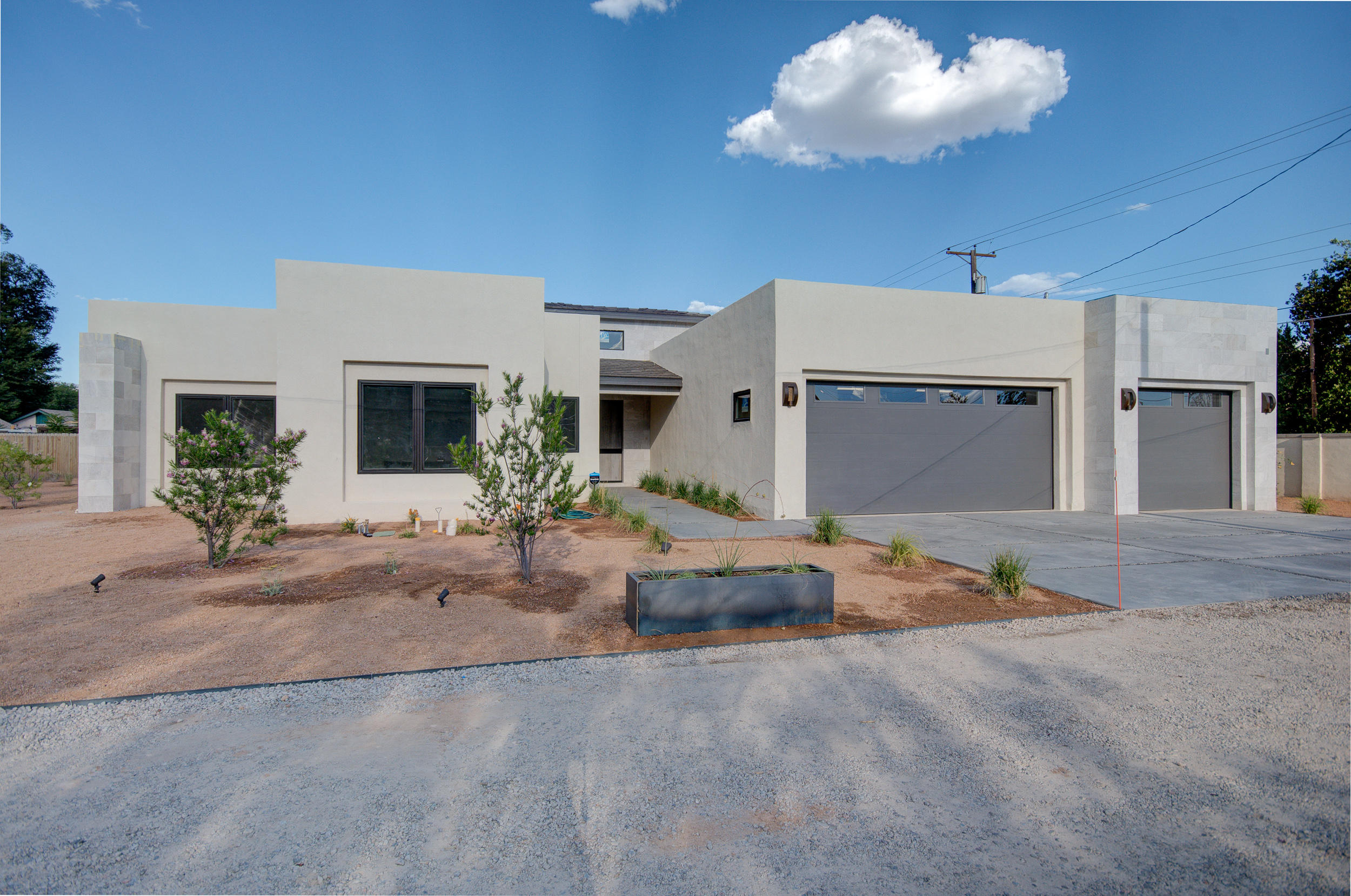 Welcome to your next forever home in the beautiful ABQ north valley!!! Mins from old town and Bosque! Care was put into this amazing custom home! Set on a private drive, this 4 bedroom property is perfect for your family and/or private business to have the room necessary to grow! Single story throughout, amazing master suite with an impressive separate shower, garden tub, connected front office with separate entrance,  closet, and bathroom access! Has an open floorplan perfect for entertaining from the kitchen to the living room! Separate formal dining area with serving counter space for large family gatherings! High ceilings allows to have the space and comfort that you're looking for in a custom home. Attention to detail on every corner of this amazing house! You don't want to miss!!