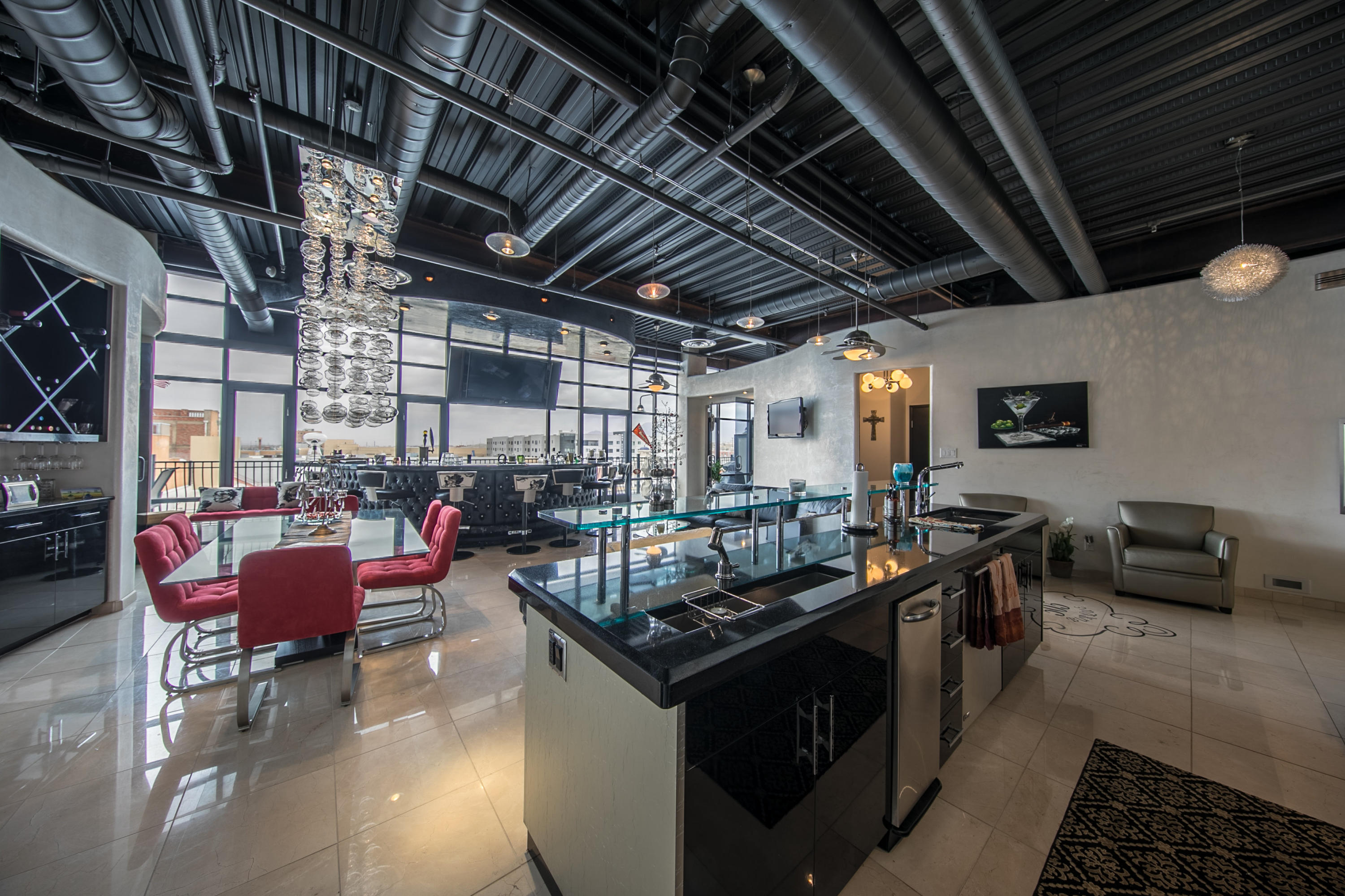 You will love the city life in this upscale luxurious custom loft.This exquisite property is located on the 5th floor at 100 Gold Ave. It offers amazing views from every room and has an extended balcony, absolutely gorgeous custom details that include granite counters floor to ceiling windows custom designed bar, custom cabinets, 2 bedroom and so much more. Call for your private tour to this exclusive property.