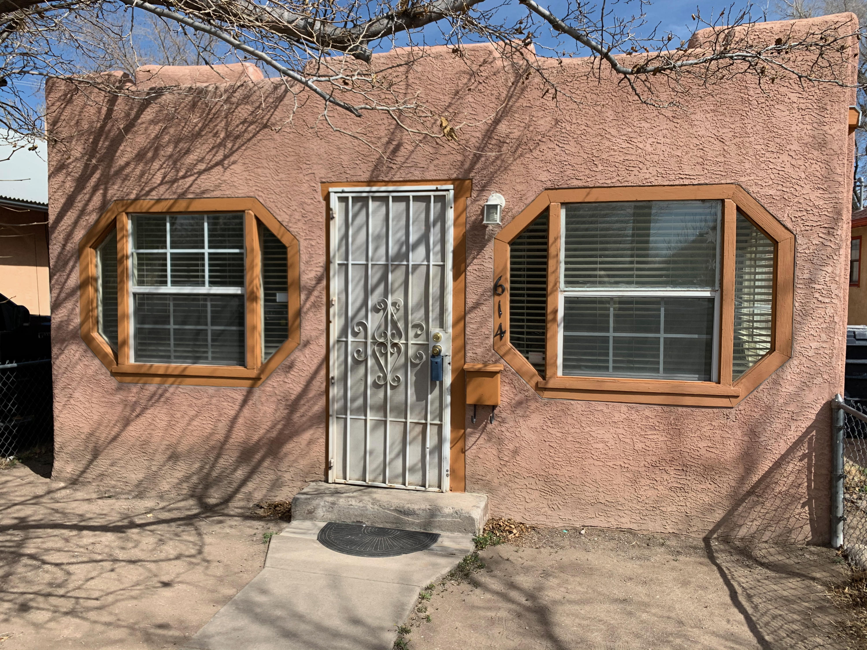 This home is located in a historic neighborhood in the heart of Downtown Albuquerque. Traditional New Mexico adobe with hardwood floors, fenced front courtyard and large backyard. Potential for investment as rental or office site.  It's conveniently located near shopping, restaurants, Schedule your visit today.