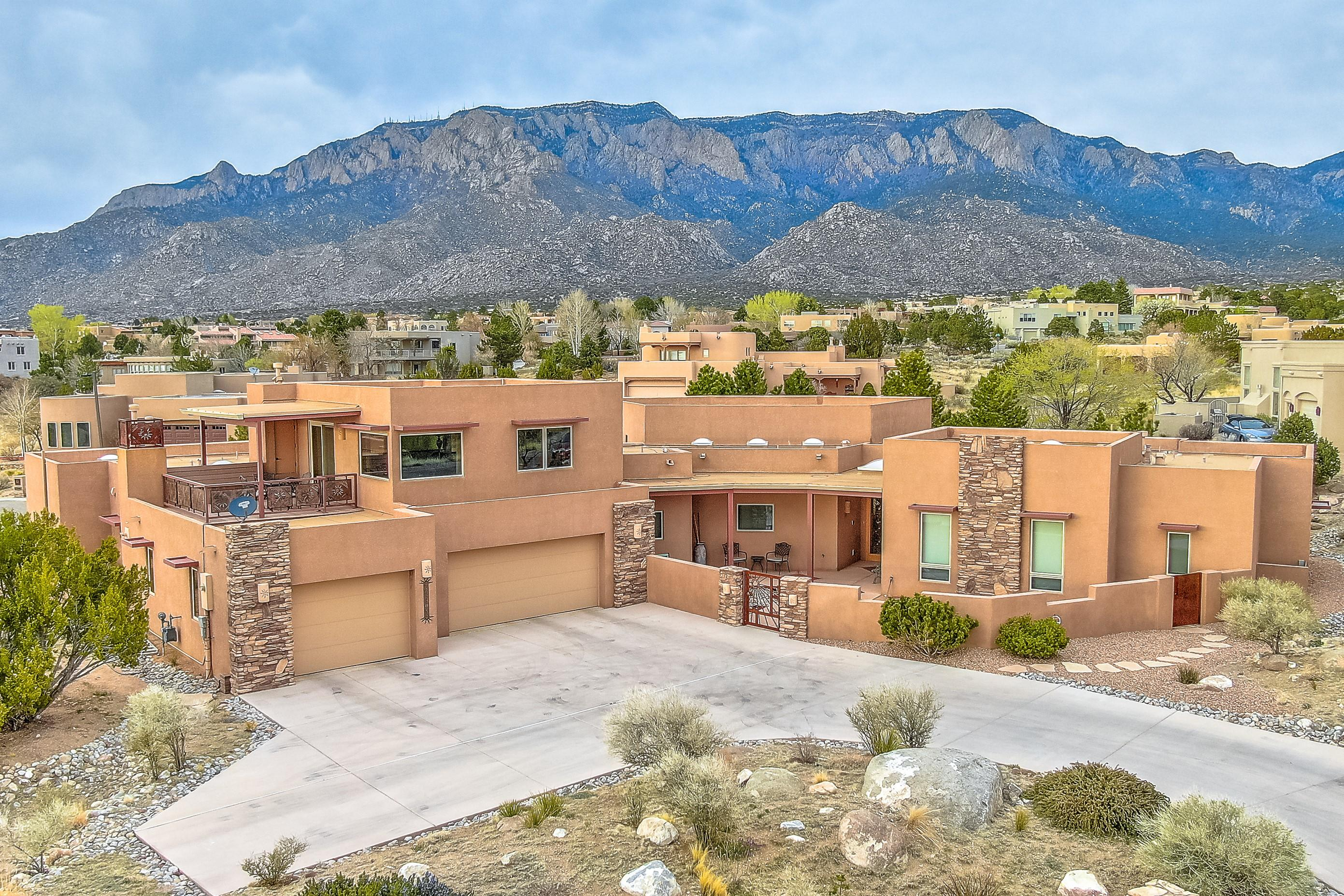 Unique High Desert Estate Lot home with a Danish Modern Vibe, Soft Contemporary/Southwest Flair, & Features that cater well to Artist, Hobbyist, Home Office, & Family needs! Single Story configuration with an Upper Level Rec Room offers a 360 Panorama of the Mountains & Valley. Well Equipped Kitchen & Expansive Island seamlessly access the Mountains & Great Room adorned with Nordic Beam accents. Master Suite with Spacious Dual Closets & a front row Mountain View from your Pillows. Home Office with a To Die For View, plus Workshop & flex Studio Space, will prime your Creative, Practical, & Business Pursuits. Thoughtful Construction & Design Detail, including ADA spec Wide Halls & Doorways. Kinetico RO Filter & Water Conditioning. Low Maintenance/Low Water Landscaping. A Spectacular Home!!