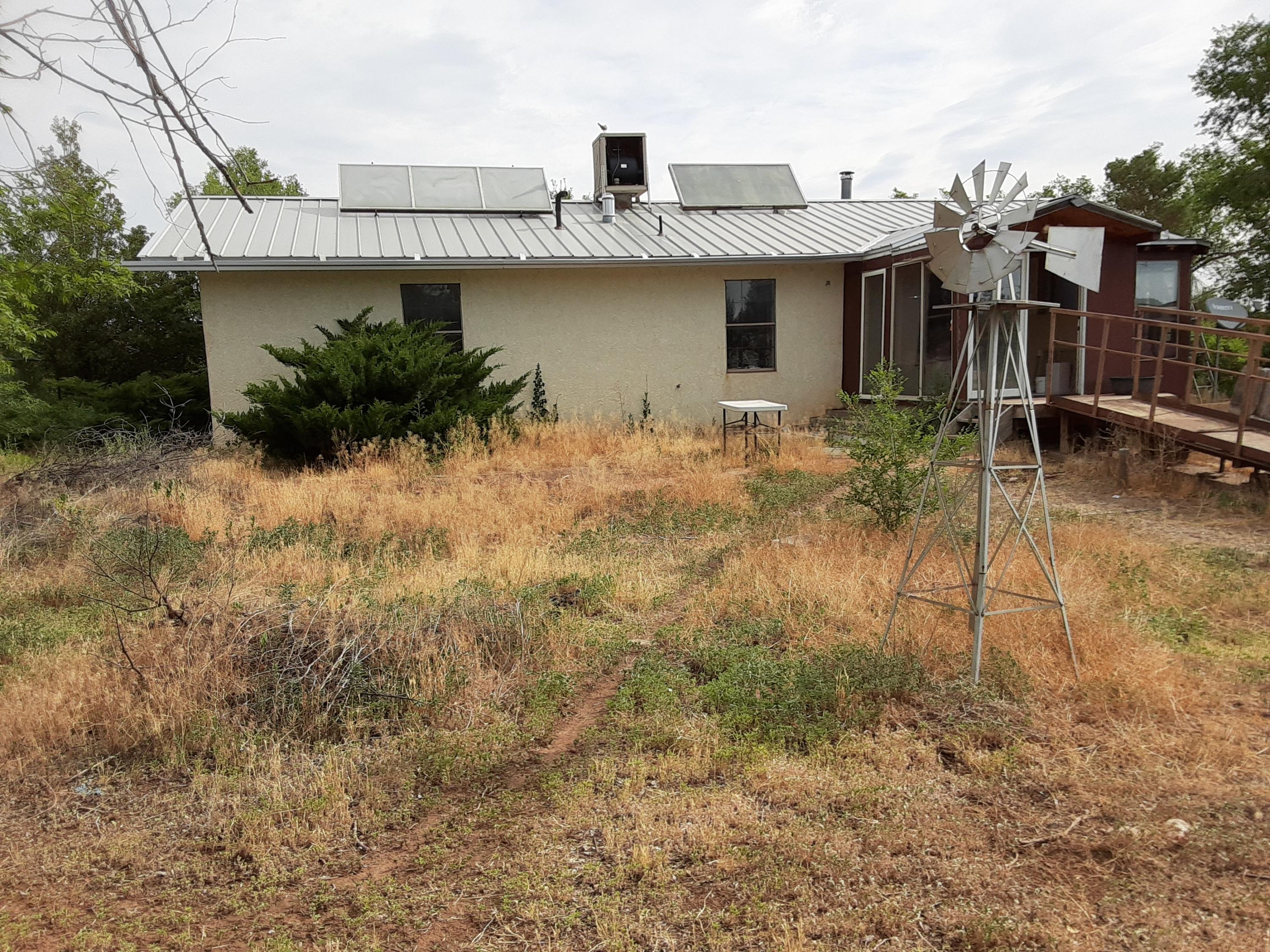 Home is on 5 acres plus 2 additional lots of 1.25 acres each, all together totaling  7.5 acres. Home is going through transition. Clean up will be done before closing.