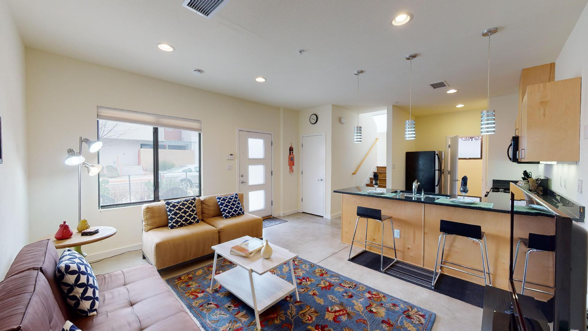 A TRUE WINNER for an easy breezy lifestyle.  Ensconced in light this Corner Unit has 2 great private outdoor patios (Margaritas Anyone???) and is just steps away from  restaurants, shops, ART (ride the mile to UNM)  & neighborhood park.  Indulge in private spacious master retreat with gorgeous hickory wood floors & from  balcony enjoy viewing the Nob Hill Nightlife or Sunsets against  the Sandias. The loft with expansive windows offers great flexibility for office, studio or guest room. Great room with sealed concrete floors effortlessly blends into kitchen with modern fixtures, maple cabinets & granite counters.Leave yard work behind and indulge in Nob Hill Living at its finest! Newer HVAC unit. HOA covers exterior maintenance incl roof, water, trash, common area maintenance & insurance.