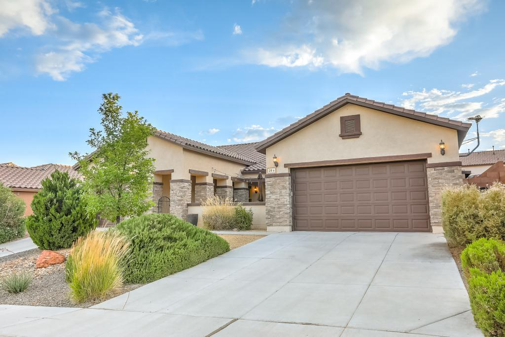 Beautiful, newer, single-story, semi-custom home that's been elegantly remodeled. Located in the highly-desirable Loma Colorado subdivision, this one of a kind smart home features 10 foot ceilings and 8 foot doors throughout and has an open feel. The home has a state of the art home security system and state of the art AV systems. This home has a gorgeous gourmet kitchen with built-in stainless steel Kitchenaid appliances, over-sized custom maple cabinets and granite countertops.The family room has a stunning hand-crafted stone wall with floating shelves. The home features a spectacular resort-style back oasis with a custom gunite pool, raised spa, a kiva fireplace and extensive landscaping. The home is a short walk to Rio Rancho HS, parks and recreational areas.