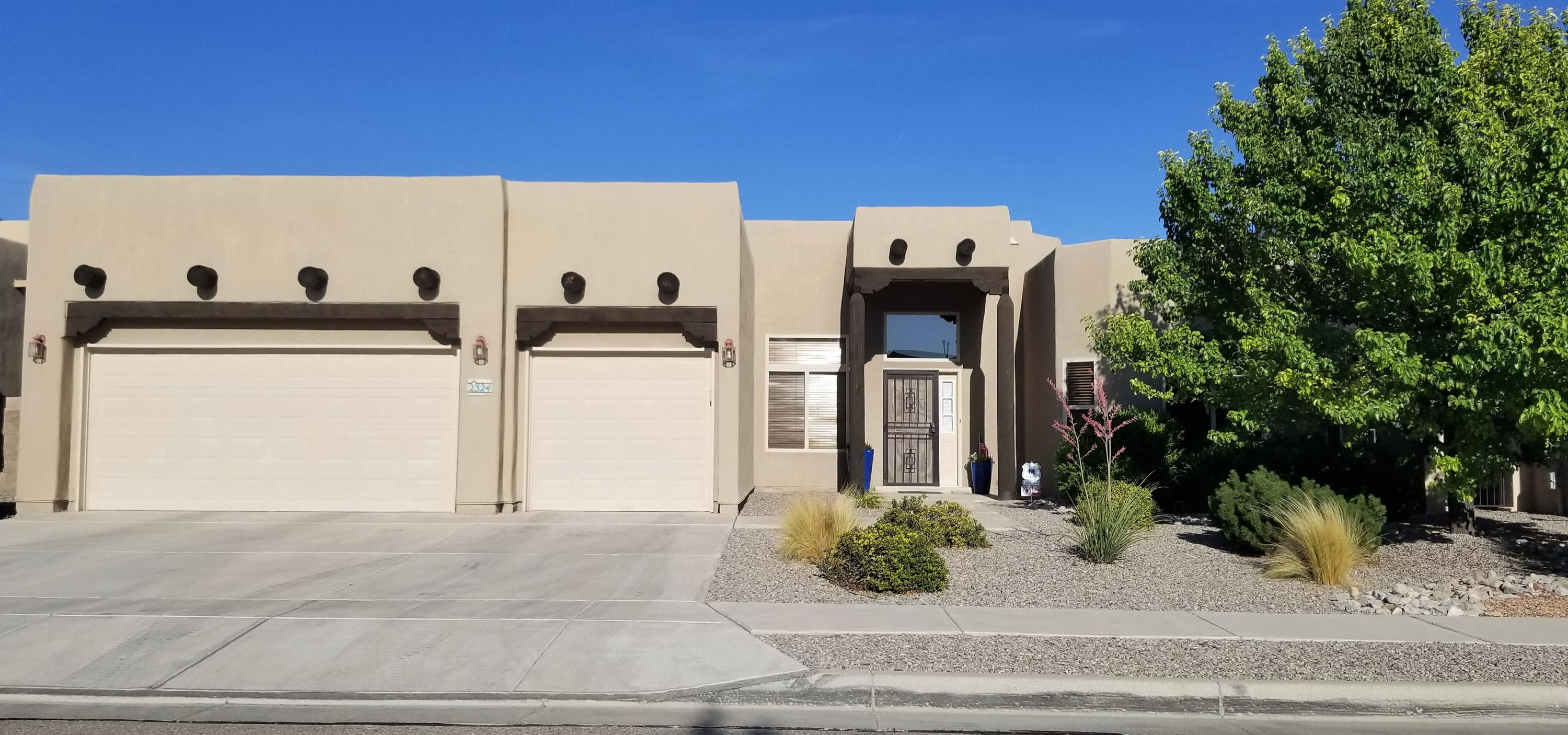Come see this immaculate move in ready Southwest style Pueblo home with all the modern touches! It was a model for Kim Brooks and has all the extras like vigas, knotty alder cabinets, lighted nichos, kiva fireplace, recessed ceiling in formal dining room, granite counter tops, breakfast bar, tile in all wet areas, 4 generous sized bedrooms, huge walk in master bedroom closet with built in shelves, master bathroom garden tub and separate shower, oversized 3 car garage, covered patio, dog run, walking trails and petroglyphs nearby, plus so much more! Don't miss out on your dream home, view it today!