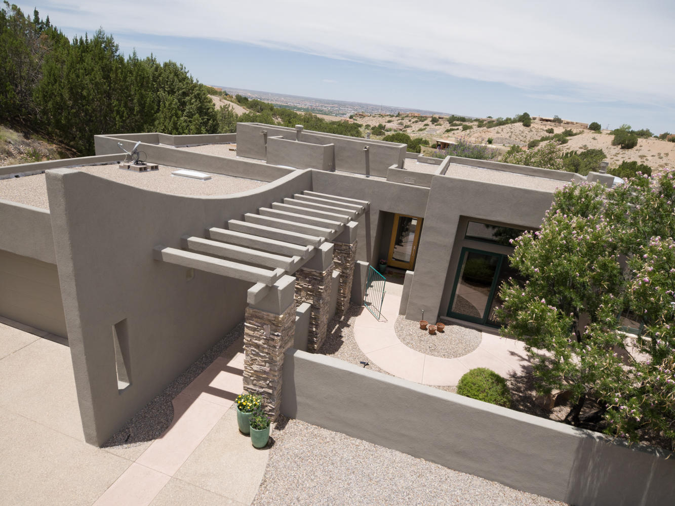 Exquisite Custom Contemporary w/ Spectacular Sandia Mountain Views!! Every detail of this incredible home has been well thought-out & designed! Natural stone columns lead to the welcoming courtyard as you enter this warm contemporary retreat featuring a half barrel ceiling in gallery/hallway; nichos; ledges; quality casement & clerestory windows; raised ceilings; & more! Remodeled kitchen w/new Corian counters & glass tile backsplash in May 2020, beautiful cabinets; new S/S appliances Nov 2019! Owner's Suite w/private courtyard; spa like bath & 2 way fireplace. Home re-stuccoed w/synthetic stucco Nov 2019; New refrig air June 2020; New hot water heater Dec 2019; Seller brought Natural gas to property, no longer on propane! Enjoy the city & mountain views in the tranquil walled courtyard.