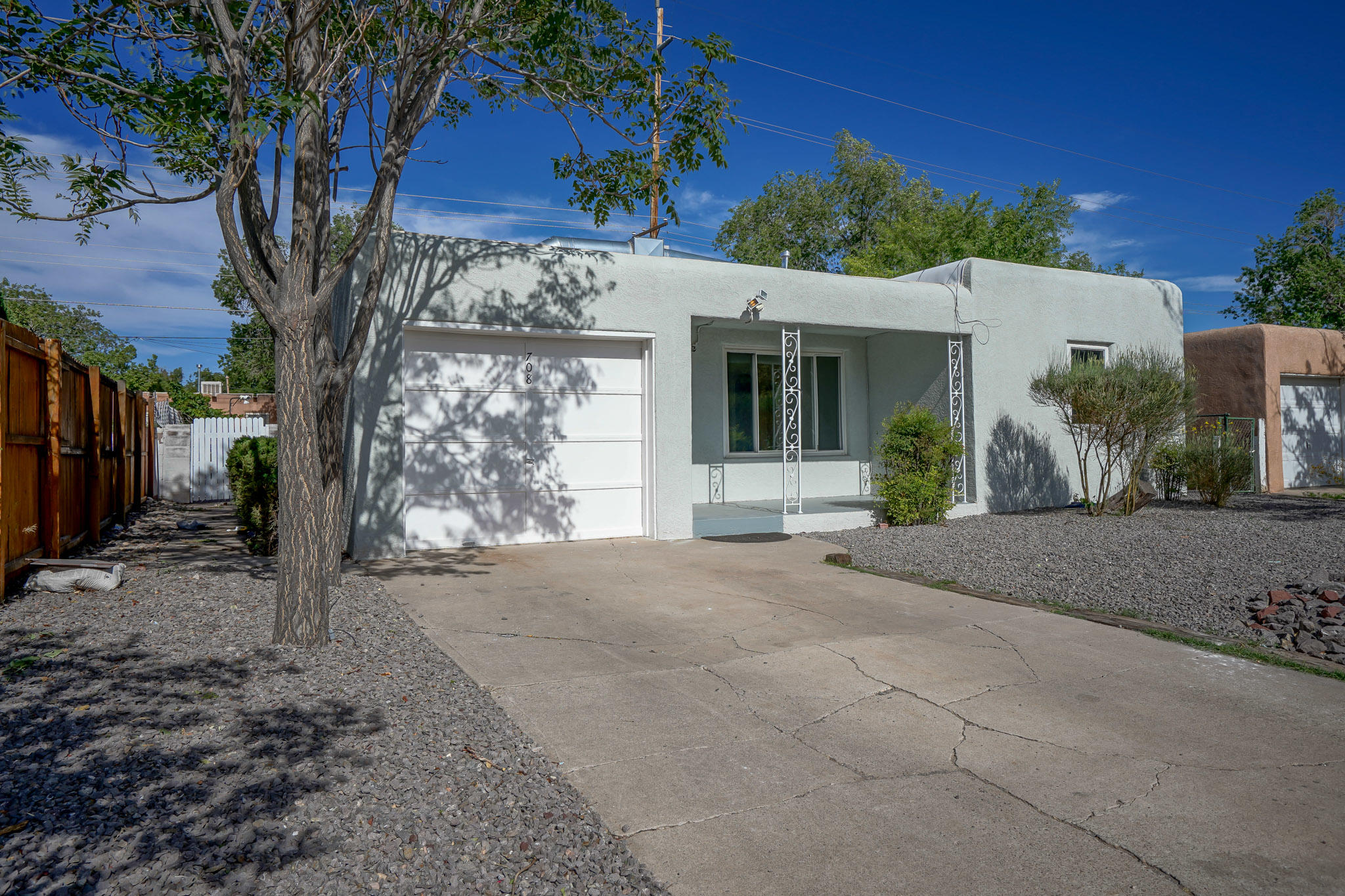 Very-nicely-remodeled, charming Adobe-Style Casa in great NE Heights- ''Fair West'' neighborhood! Ideally situated between UNM & Uptown-shopping centers, Nob Hill! Kirkland & I-40 very close by!Renovations include: Refurbished cabinets in kitchen, new stainless-steel appliances; new raised-panel interior doors w/new Santa Fe-style black hardware; new granite countertops, sink & faucet; new custom tile flooring in kitchen & 3rd BR (office/study); stunning refinished, original hardwood floors thruout rest of home; new toilet & BA vanity; new custom, surround tile in BA; new light fixtures; new paintwork thruout; refurbished windows. New front & back SW landscaping. New TPO roof w/transferable warranty. New/Less than 1-yr heating units. Skylight;Cove Ceilings;FP. Light & wonderfully bright!
