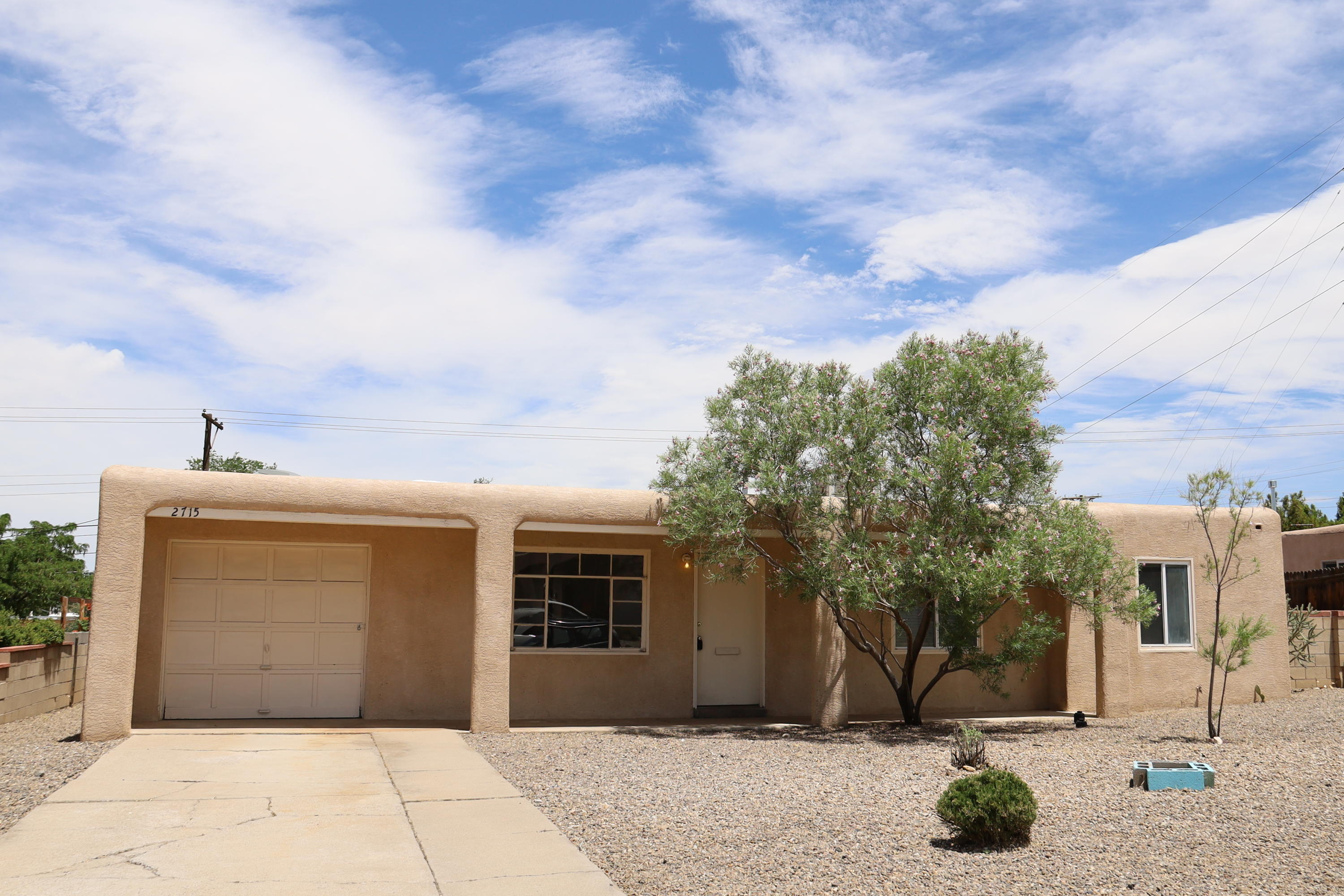 Diamond in the rough.  Great location with good access to UNM and shopping. Garage in Backyard can be accessed from Indian School Rd. Garage has ample room for storage, work shop or hobby room.