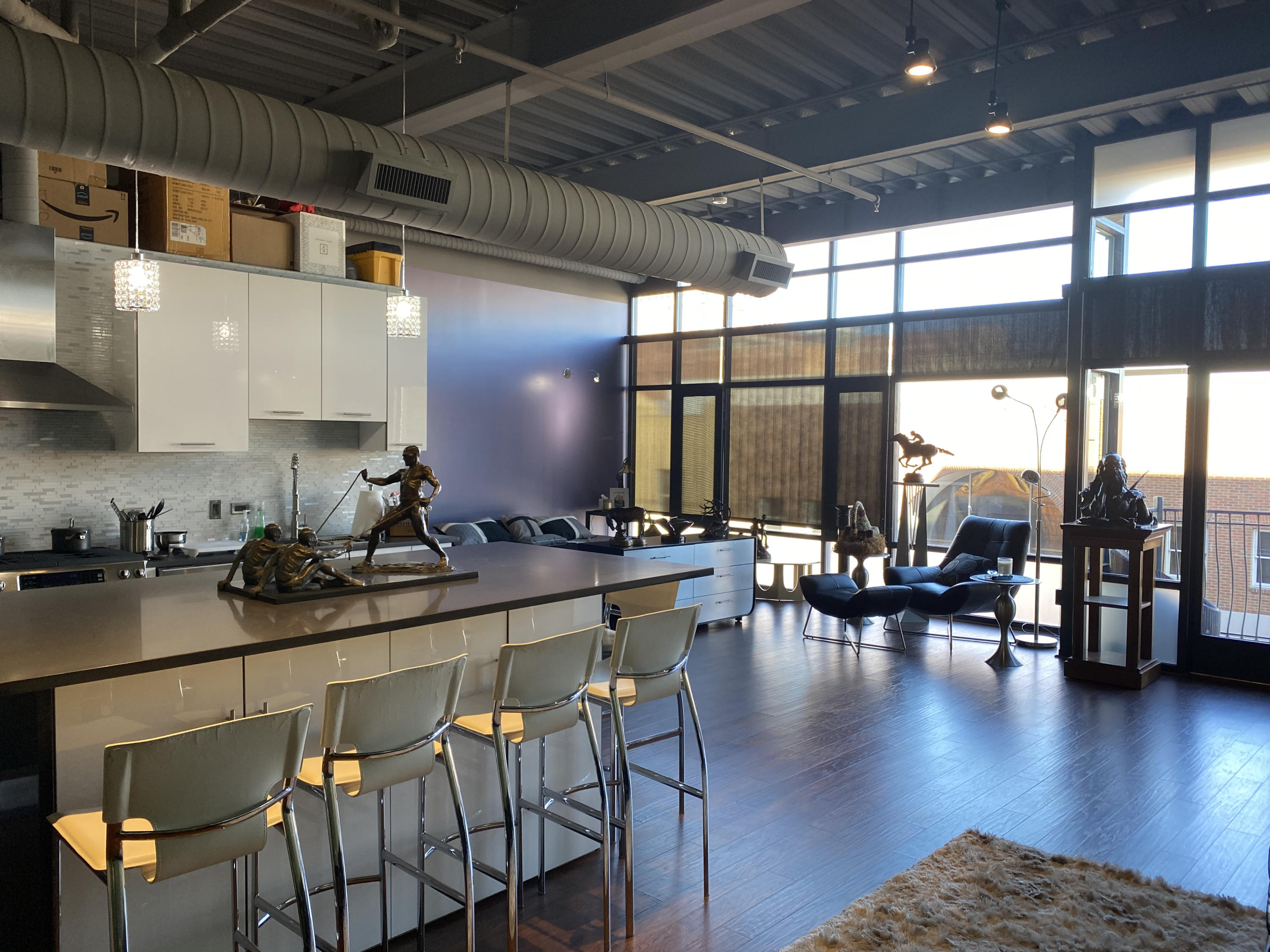 Spacious oversized studio maximizing the 1,112 SF space for entertaining and urban living in this perfectly located glass and steel building.  This loft features a new designer kitchen with an island that can be used as a high-top dining table for up to ten people. The island has additional cabinet space on both sides.  Brand new floors throughout.  Deluxe custom organizers line three walls of the bright closet, where space is maximized with adjustable telescoping rods and expanding shelves so you can easily customize to your personal shelving and hanging needs. Upgraded LED lighting throughout. Full bathroom with Kohler tub and double sinks, as well as washer/dryer. Floor-to-ceiling windows. Nice balcony approximately 55 SF with exposed brick on one side provides great views.