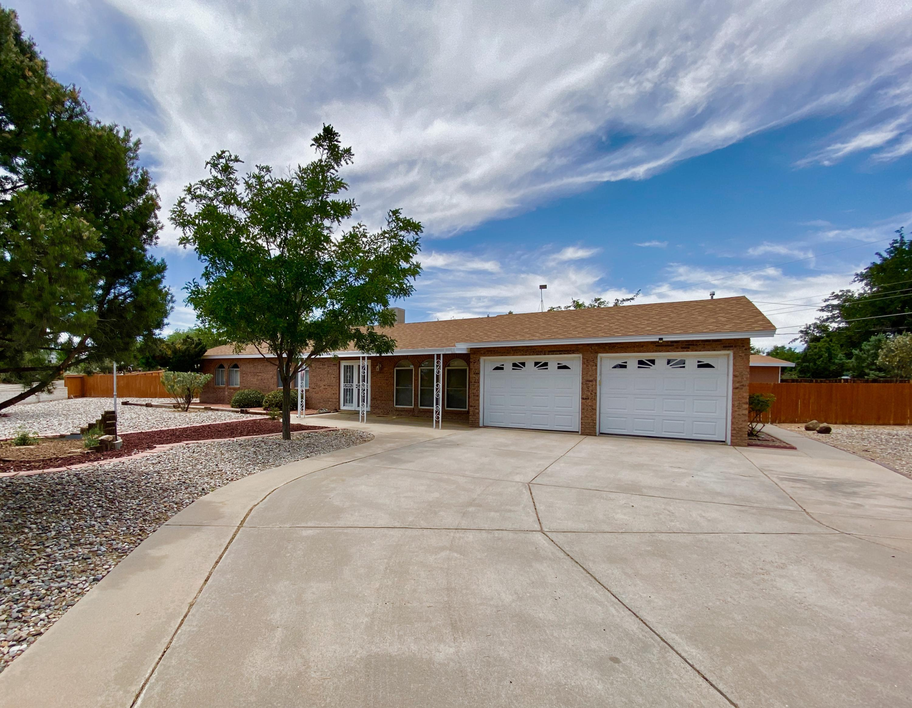Space to Dream & Room to Grow! If you are in search of a one story ranch style brick home in the Heart of Rio Rancho, on expansive corner lot (.62), then this property is a ''must see''.Glass French doors welcome you into this light filled home with large living spaces. Bright living room & formal dining room, wonderful for gathering friends & loved ones. The country kitchen offers ample storage & opens to one of two large covered patios. And with sizable backyard access you will have room to store your RV, boat or even add a casita; PLUS the two outbuildings provide you all the room you need to indulge your hobbies & passions (one is two levels w/ wtr & electric). The oversized heated garage boasts 2 insulated garage doors w/ openers & utility sink. Newer Wtr Htr. Frig/Washer/Dryer Stay!