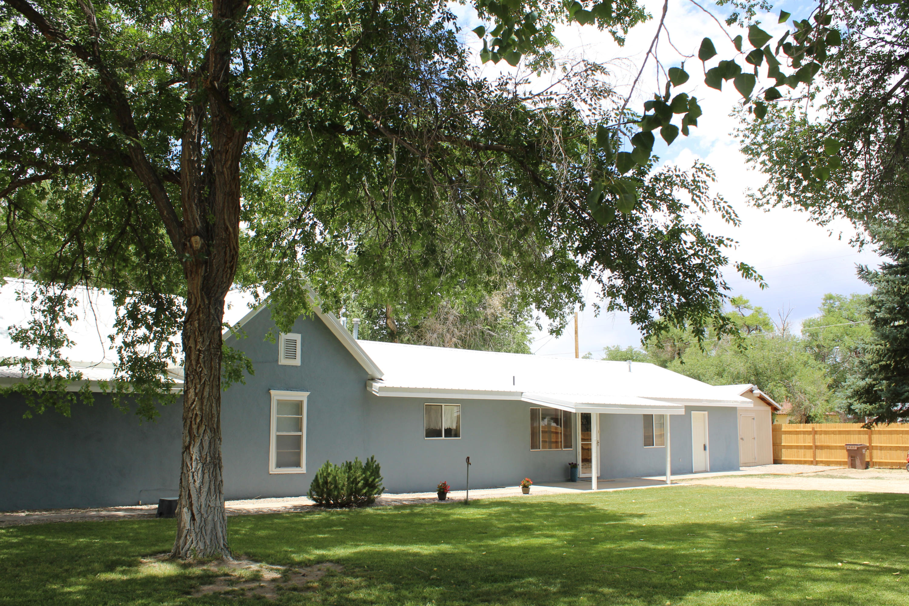 This recently updated home with a beautiful well-maintained yard is located in the quaint town of Estancia, New Mexico. This is small town America with a lifestyle that is easy going and rural. The home is 4 bedrooms and 2 baths, has a large spacious living area with a stacked rock accent wall and pellet stove. The kitchen has an abundance of cabinetry and storage space including a small basement. There is an office area just off the master bedroom with a utility area and a separate entrance. The backyard is newly fenced and is a great area for small animals. The Cibola National Forest is close by for recreational opportunities and Albuquerque and Santa Fe are both easy commutes in about an hour.