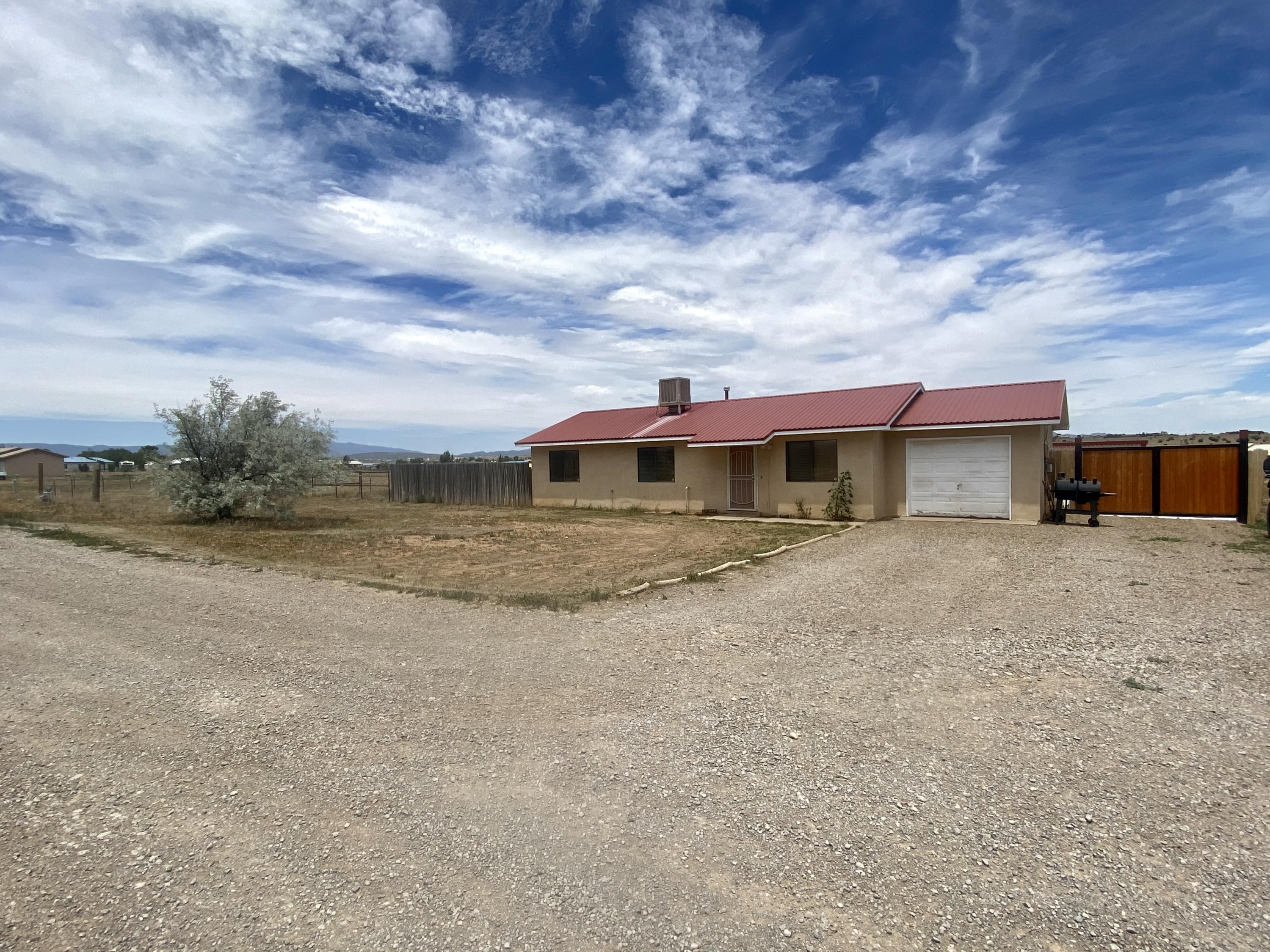 First Time Homebuyers-This one is for You!  Cozy 3 bedroom home with wood laminate flooring throughout, ceramic tile in kitchen, fresh paint, metal roof, pipe fencing, small barn for animals and a storage building. Schedule to see today...you won't be disappointed here!!