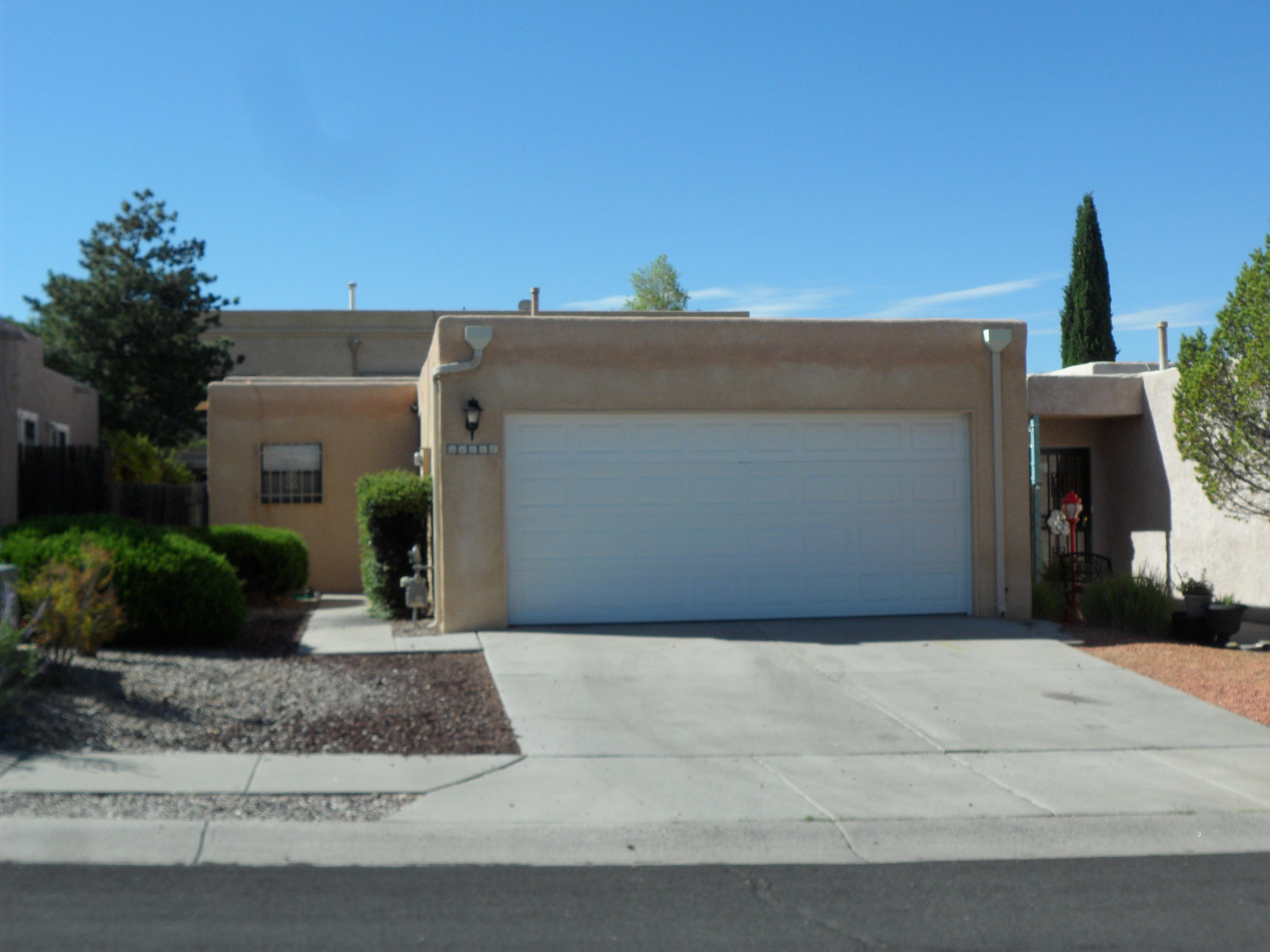Come view this adorable townhouse in the North East heights with views of the Sandia's! 2 BR  & 2 BA with new blinds, carpeting and newer vinyl planking. Oversized two car garage and new water heater in 2019. This location is fantastic, near shopping, restaurants and a path.  No Sellers disclosure will be provided.