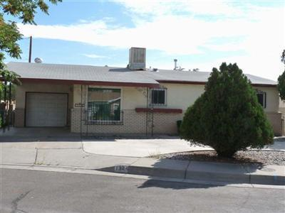What a great find! 3 bed 2 bath home, with a possible 4th bedroom adjacent to the master, would make a great office space or nursery. 2 living areas, one with a fireplace. New carpet and paint in September 2018. New washer and dryer in May 2019. The kitchen and bathrooms need some loving touches, but over all in great condition! Enjoy the spacious 10x20 covered back patio & Storage Building. Easy Access to 4th, Montano, I-40. Garage is a partial conversion. Approx 12x11 so could be a motorcycle or compact car garage.