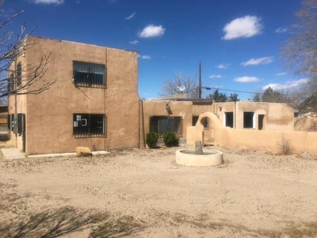 Opportunity  ,Nice two story House located  in a huge lot with big rooms, large living room ,laundry room with space for a possible 4 bedroom, Plus  Additional structures in need of work ,this property is  legally able to have multiple dwellings